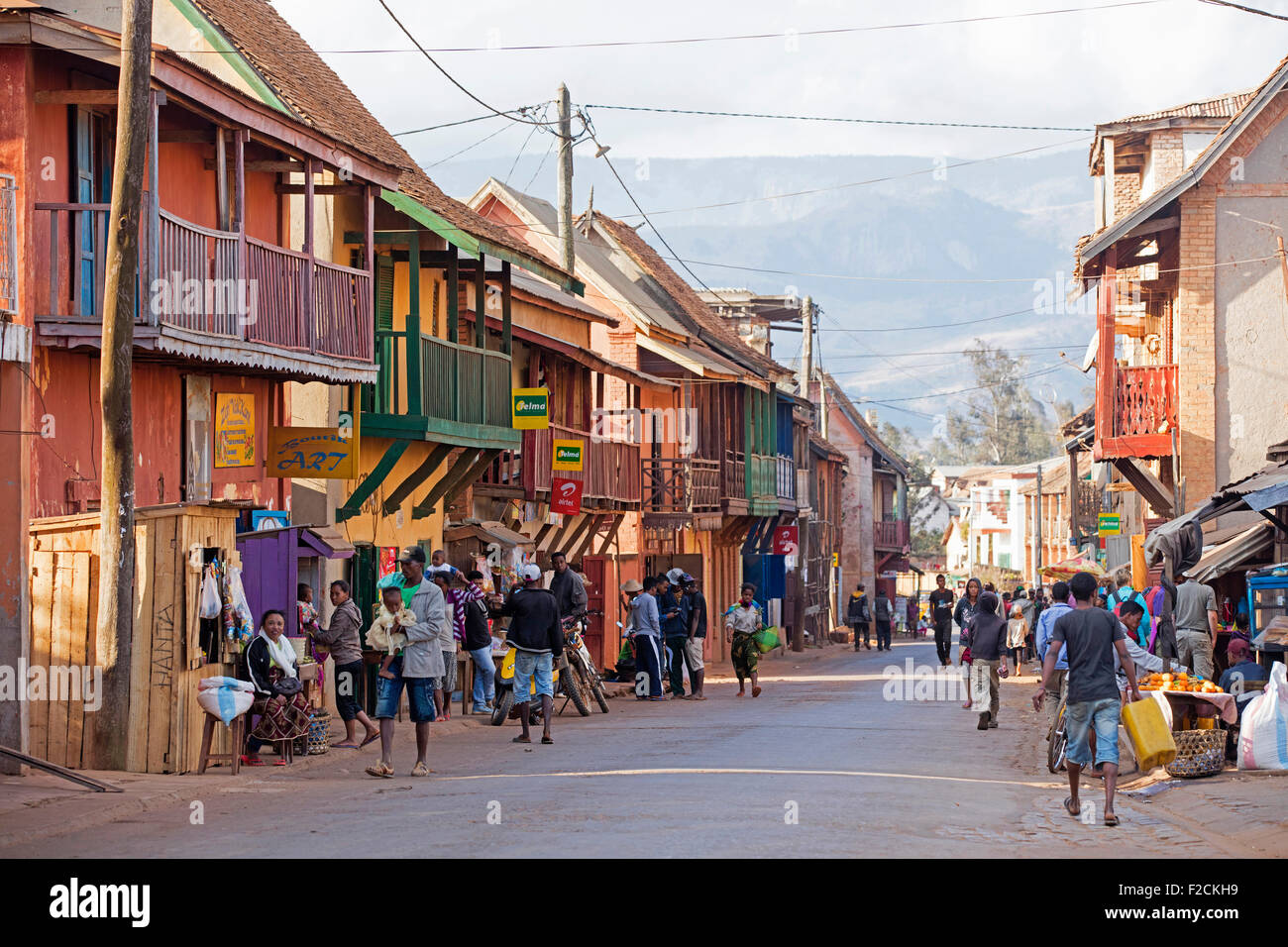 Malagasy locals shopping in the colonial main street of the city Ambalavao, Haute Matsiatra, Madagascar, Southeast - Stock Image