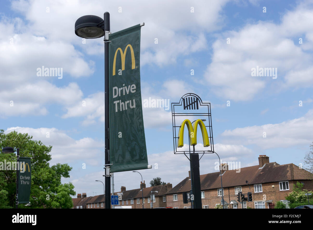 Signs for a drive-through McDonalds in the premises previously occupied by The Gate public house in Bromley. Stock Photo