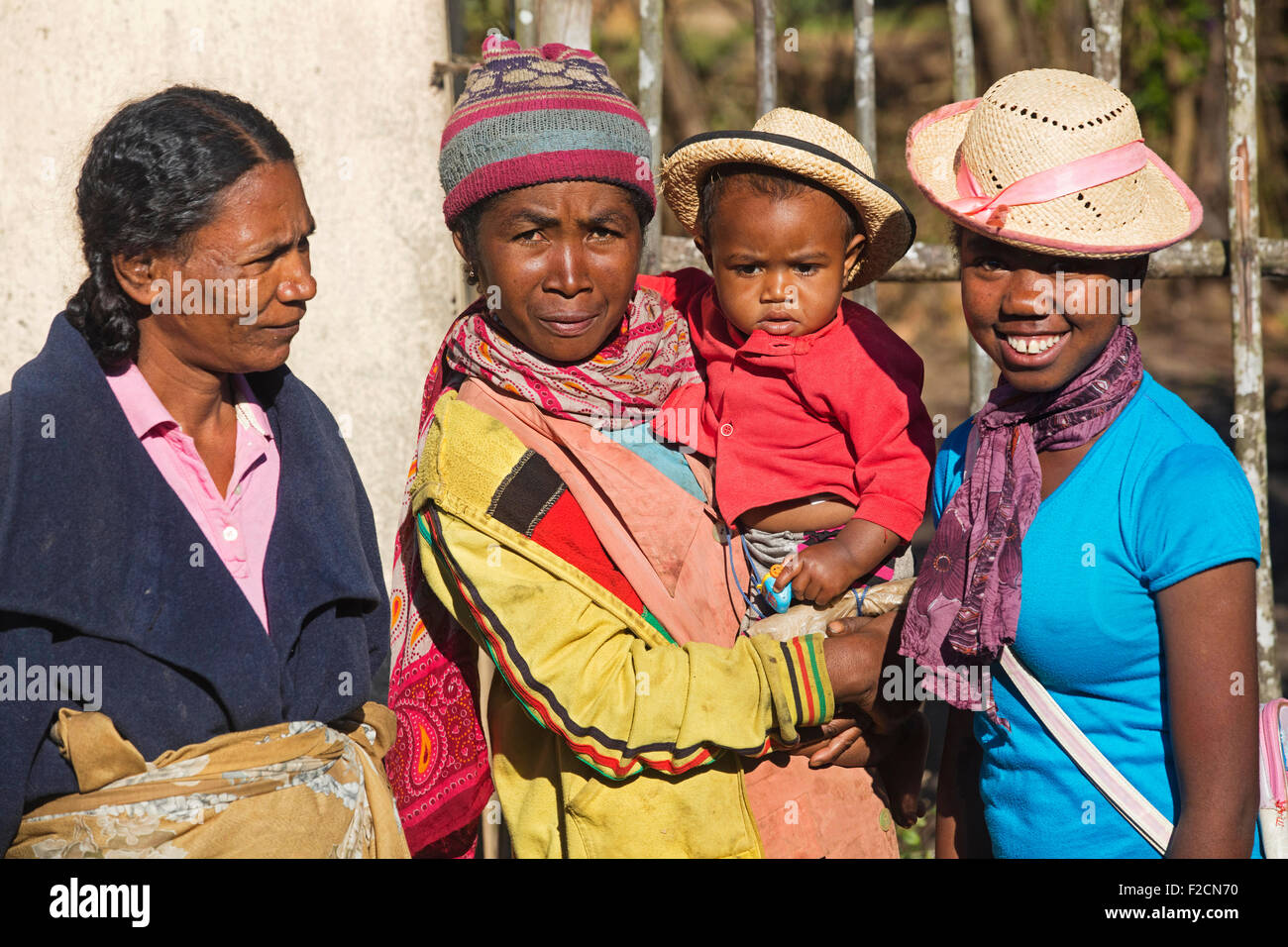 Close up portrait of Malagasy women with toddler, Madagascar, Southeast Africa - Stock Image