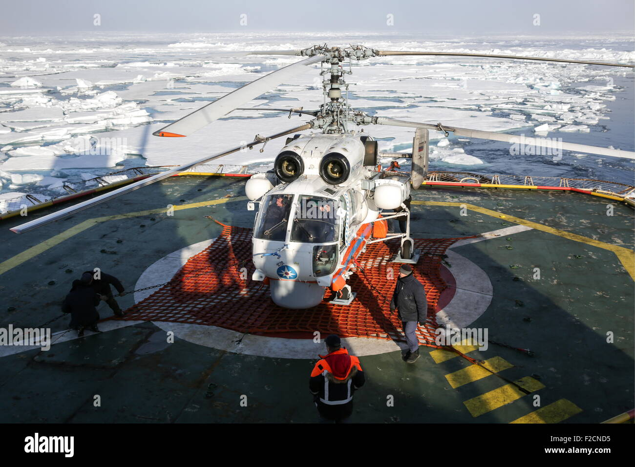 ARCTIC. AUGUST 11, 2015. A Ka-32 helicopter evacuating polar explorers of the Russian North Pole-2015 drifting ice - Stock Image