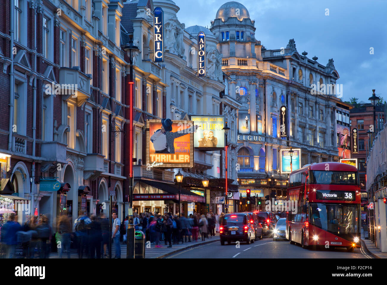 London Theatreland at night, Shaftesbury Avenue, with bus and crowds of people - Stock Image