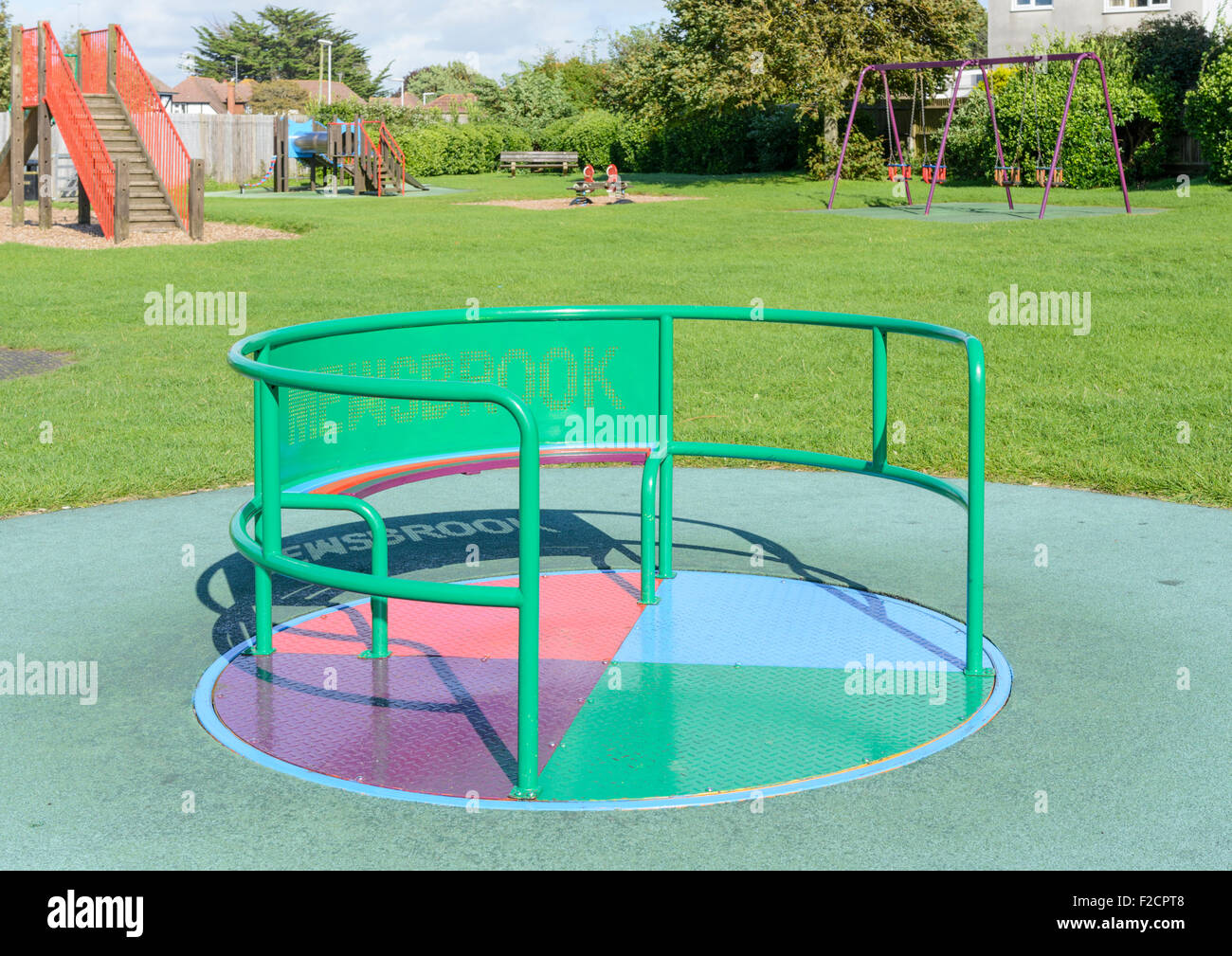 Spiro Whirl Roundabout in the playground in a park. - Stock Image