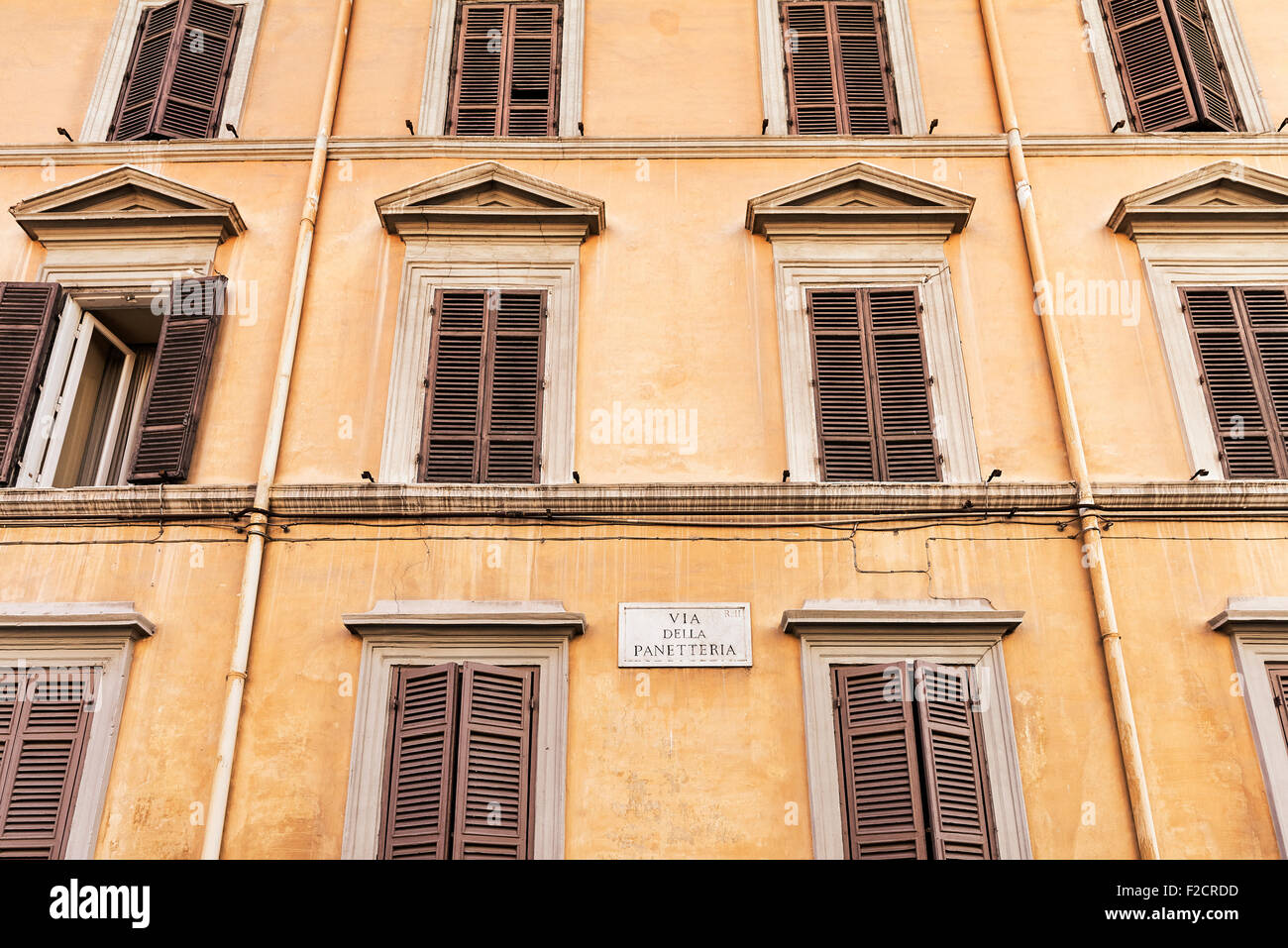 Colorful old building with shuttered windows, Rome, Italy - Stock Image