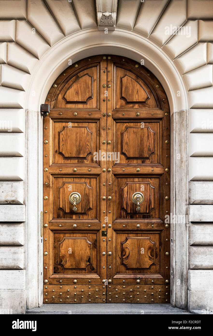 Ornate arched double door, Rome, Italy - Stock Image