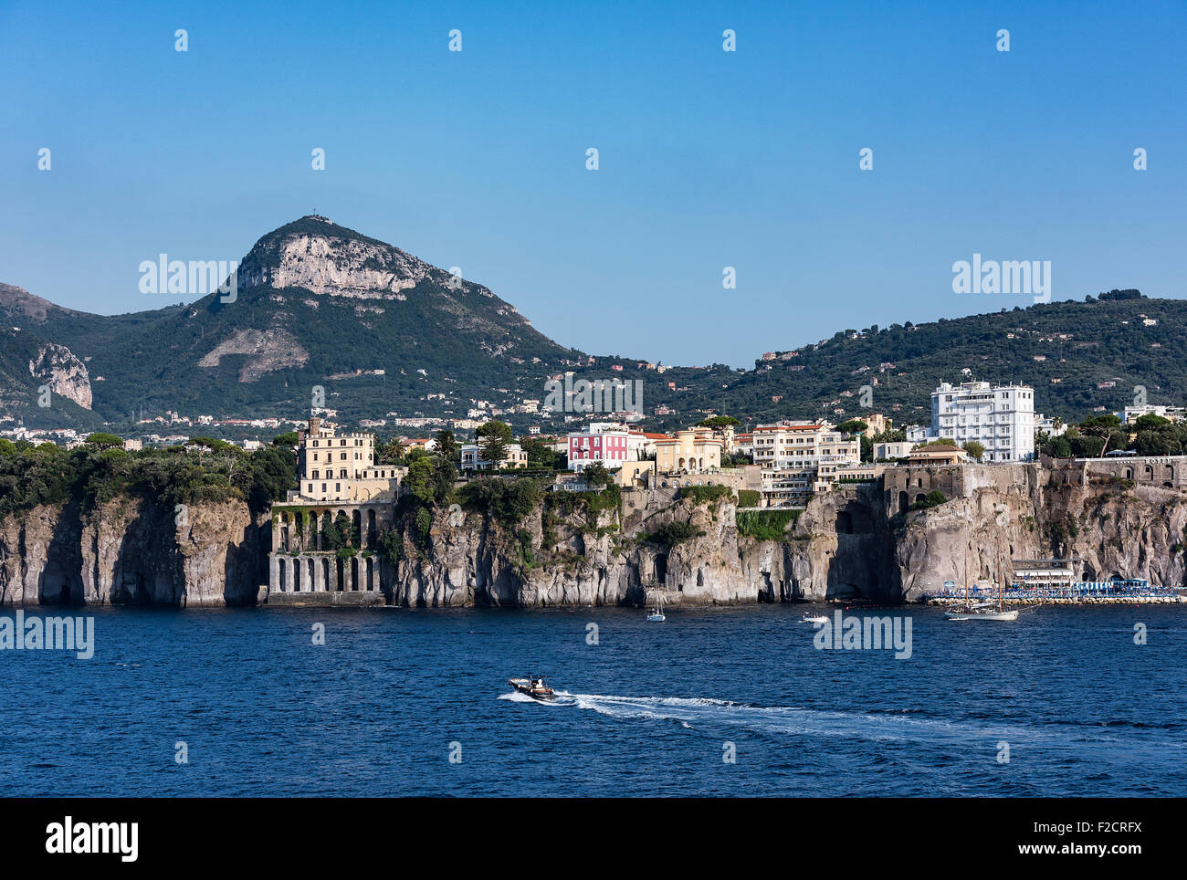 Sea cliffs and waterfront architecture, Sorrento, Italy - Stock Image
