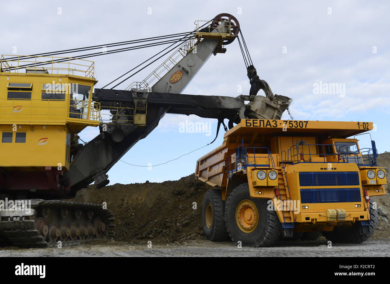 Murmansk Region, Russia  16th Sep, 2015  Excavators and trucks at