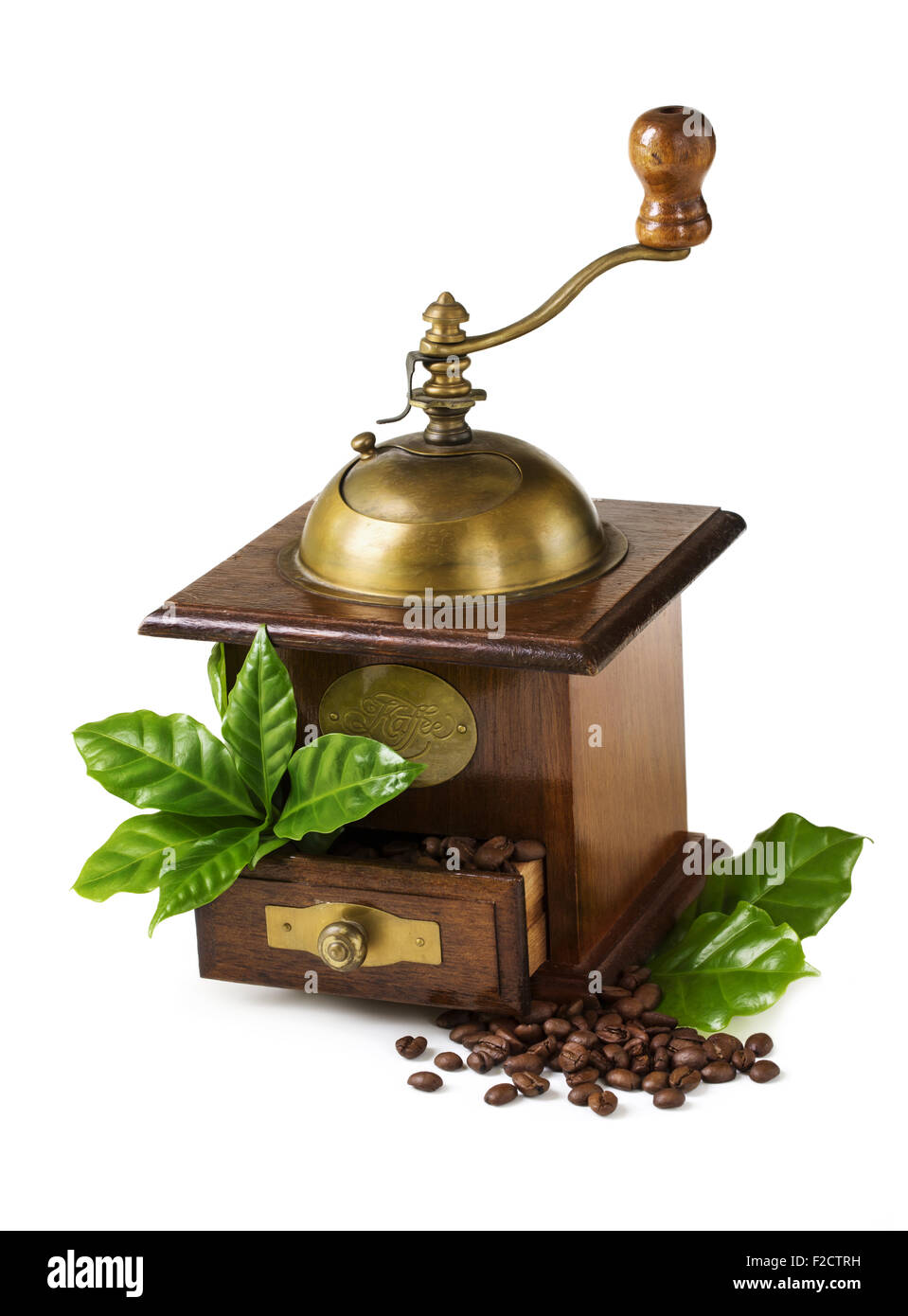 Old coffee mill with beans and leaves isolated on a white background - Stock Image
