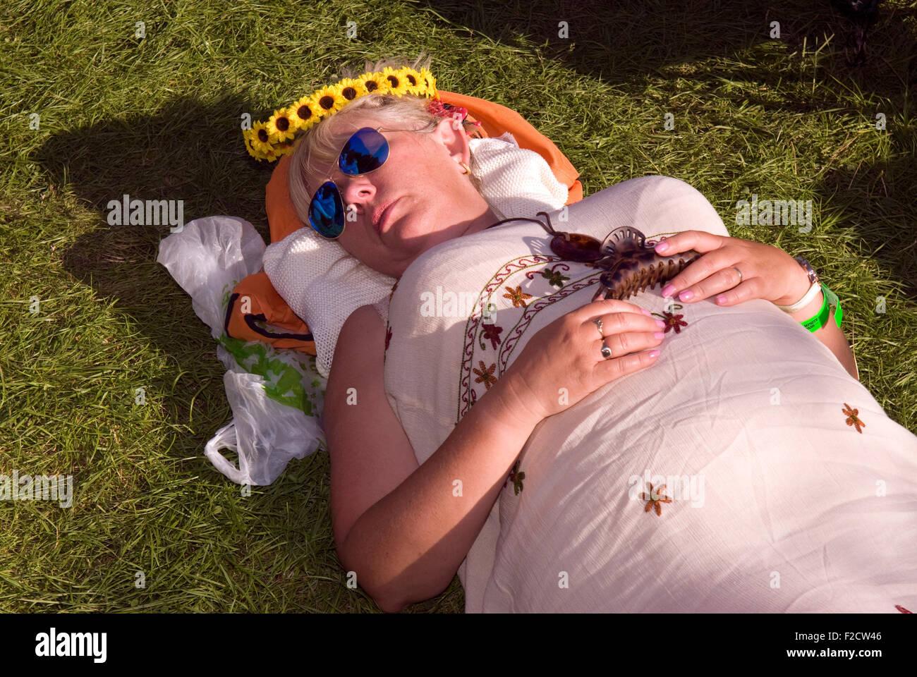 Festival goer taking a nap at the Weyfest 2015 Music Festival, Rural Life Centre, Tilford, Farnham, Surrey, UK. - Stock Image