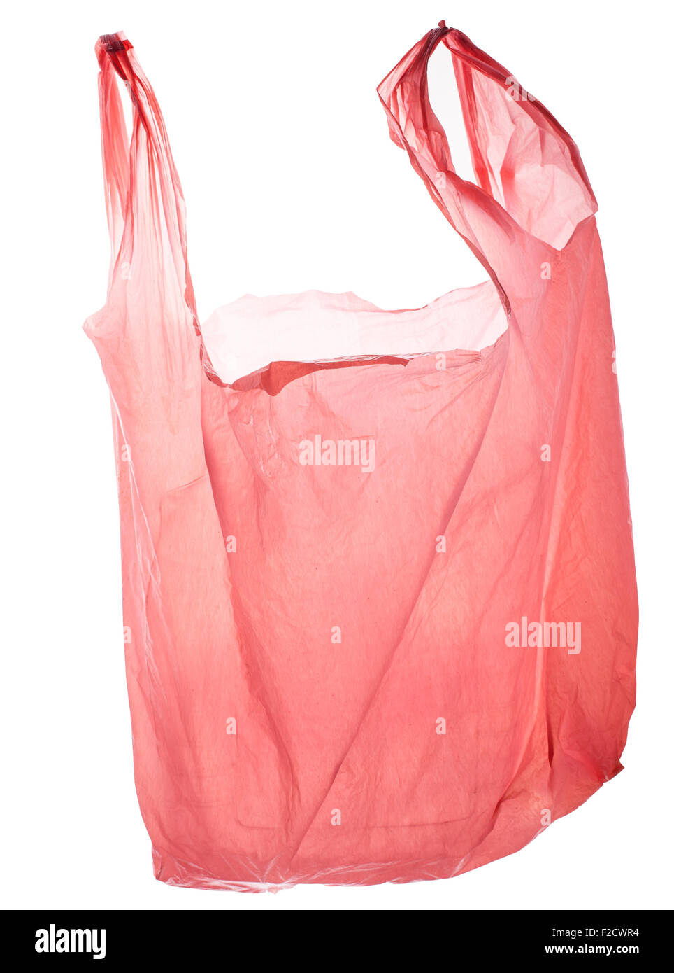 Empty pink plastic bag, back lit, floating - Stock Image