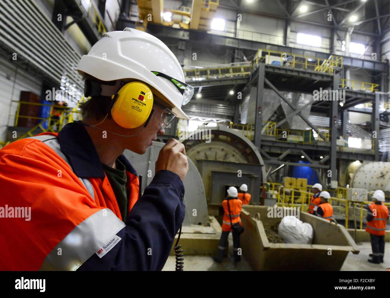 MURMANSK REGION, RUSSIA  SEPTEMBER 16, 2015  Workers at