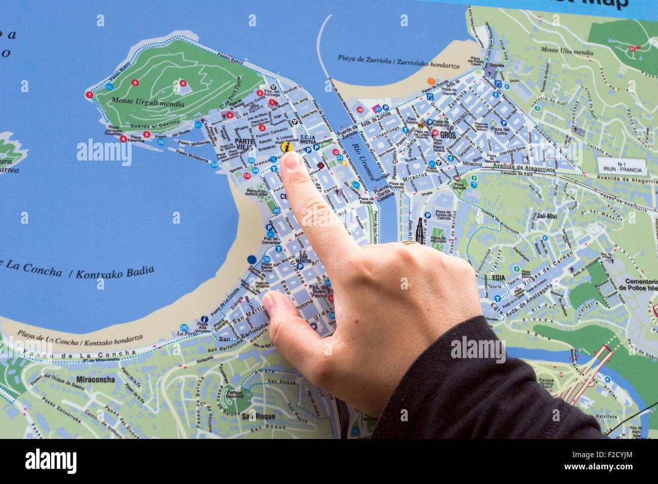 Map Of Spain San Sebastian.Woman Touching Map Of San Sebastian Spain Stock Photo
