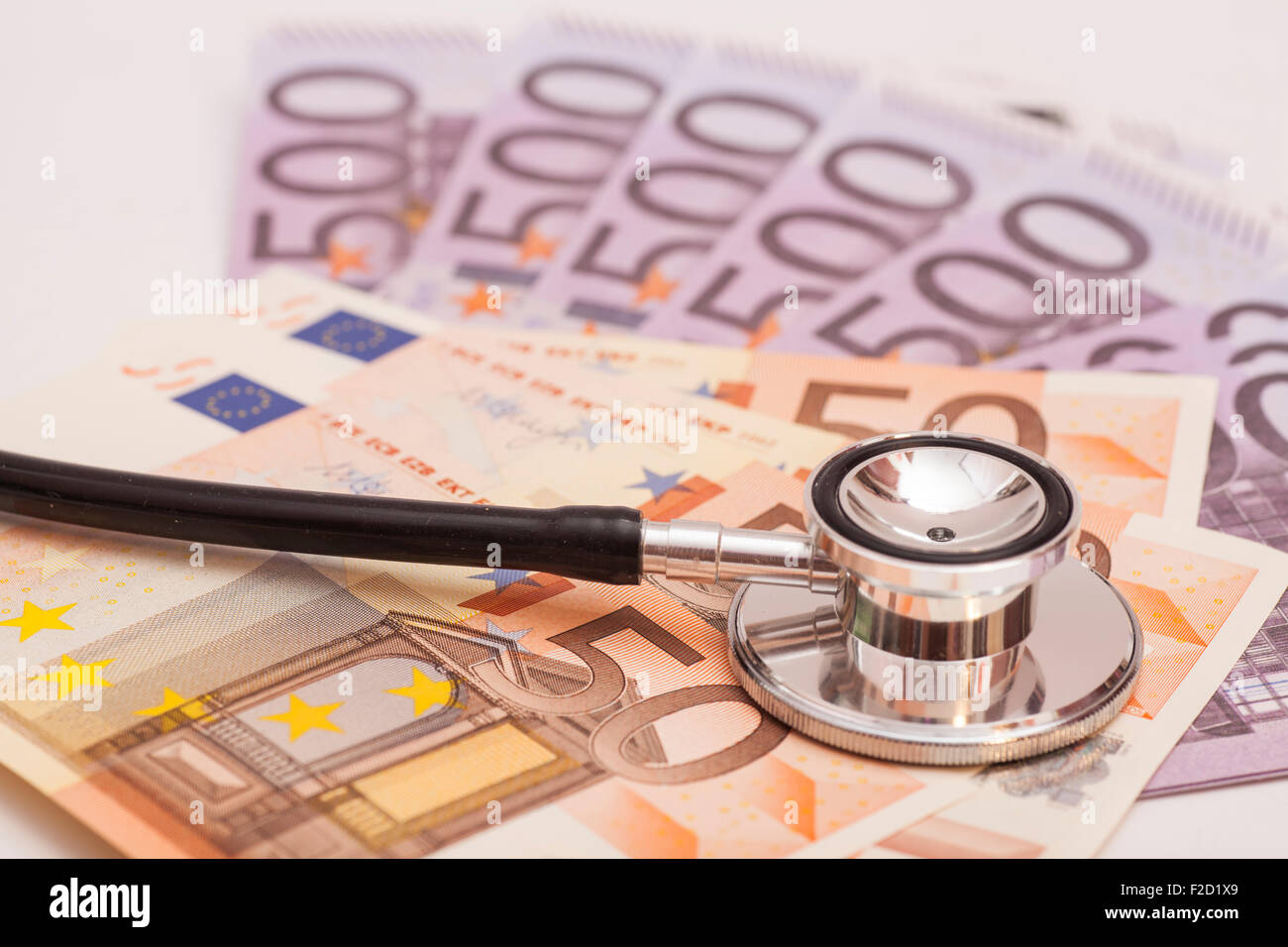 Euro banknotes and stethoscope - Stock Image