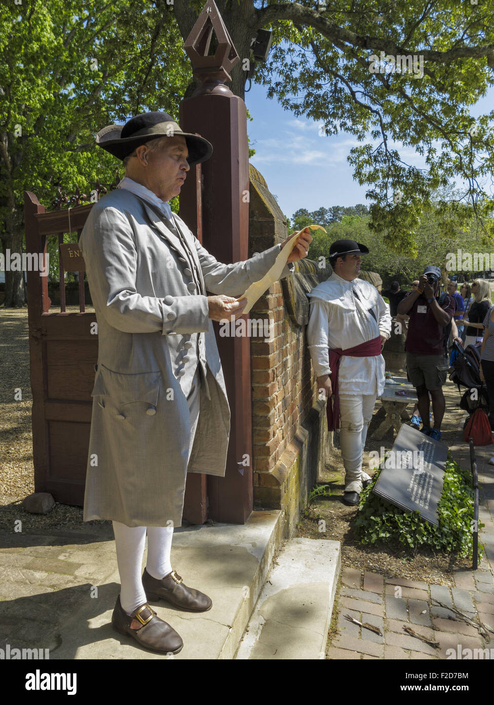 Man in historic garb reading the Declaration of Independence at the Colonial  living-history museum Virginia USA - Stock Image