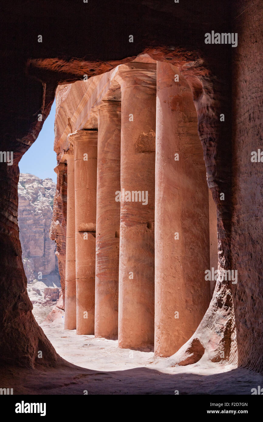 Urn Tomb portico framed by stone tomb portal in the Nabataean ruins at Petra, Wadi Musa, Jordan - Stock Image