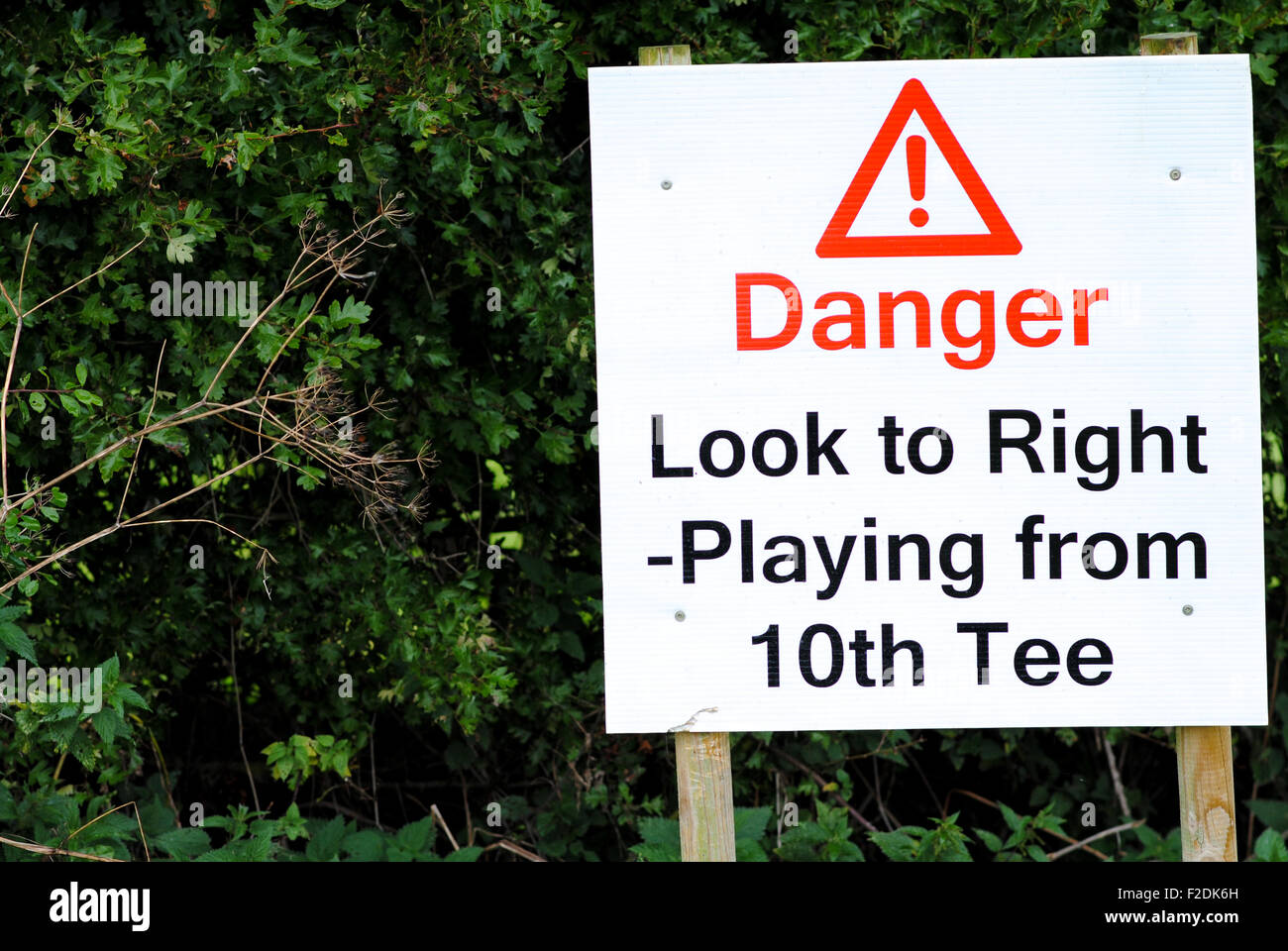 Danger golf golfers sign - Stock Image