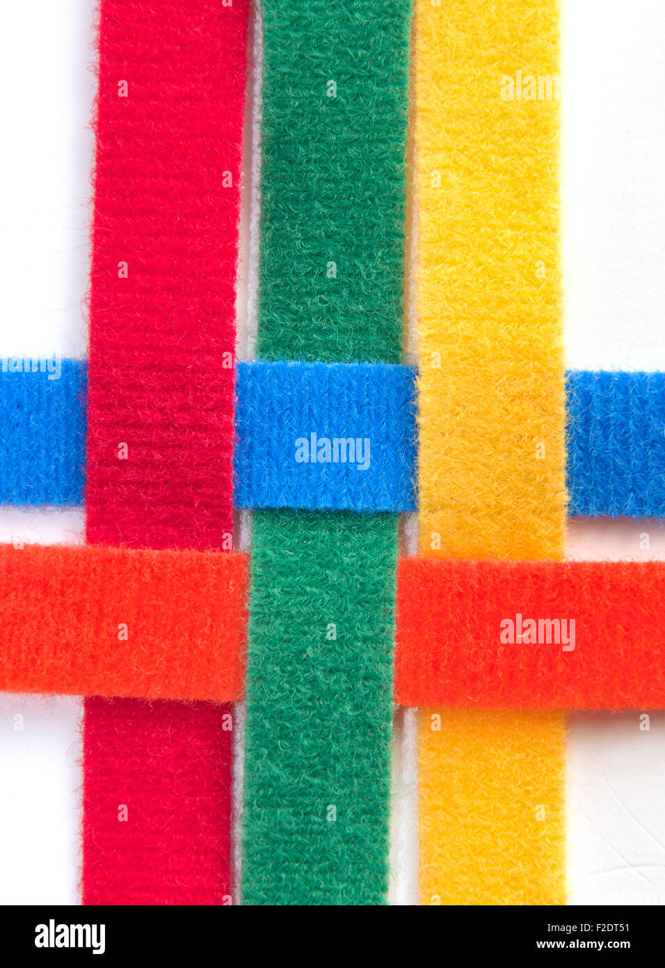 Colorful velcro strips braided together - Stock Image
