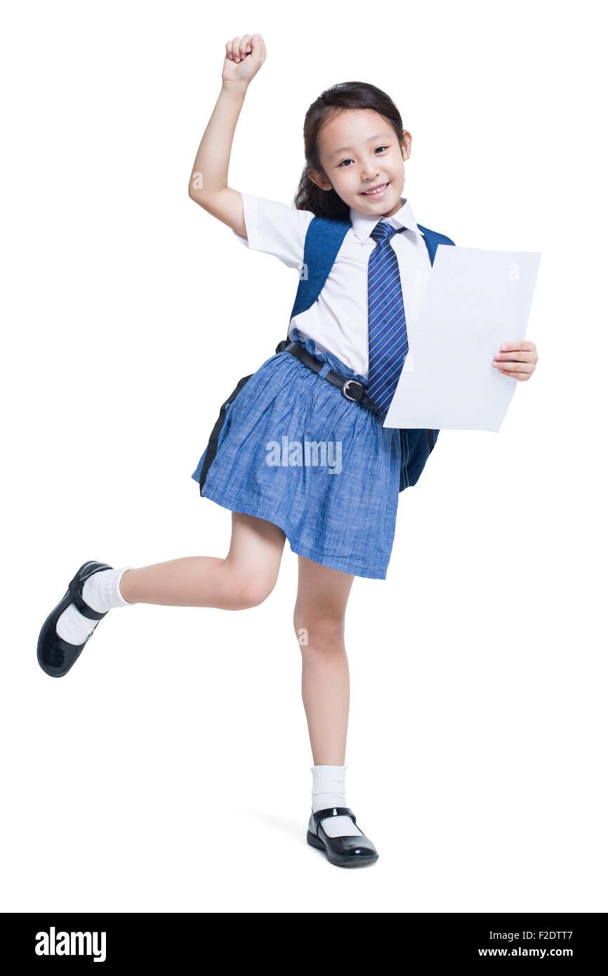 Happy schoolgirl with report card - Stock Image