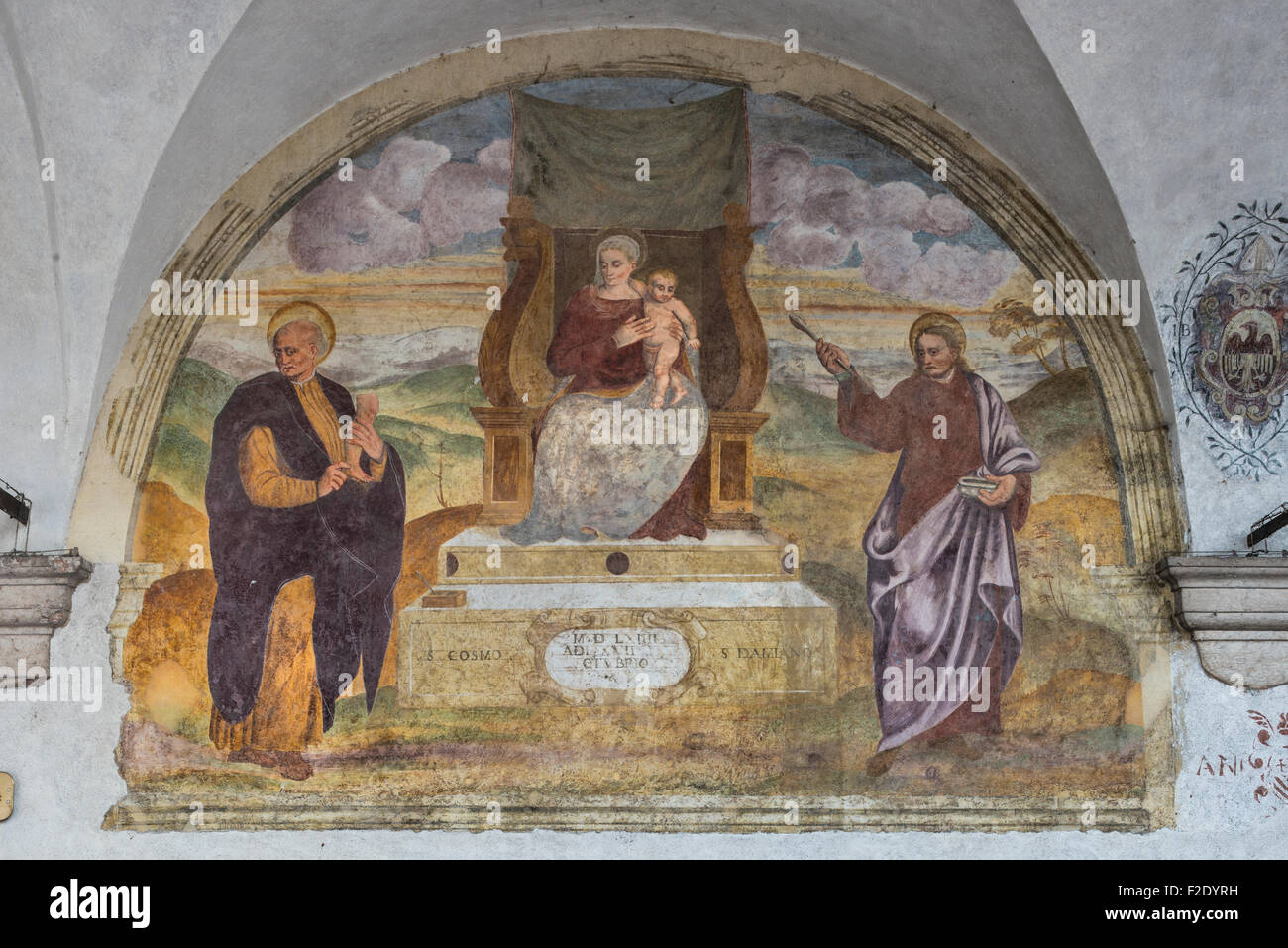 Fresco at the church of San Rocco, 16th century, restored in 2002, Virgin Mary, Holy Doctors Cosmas and Damian - Stock Image