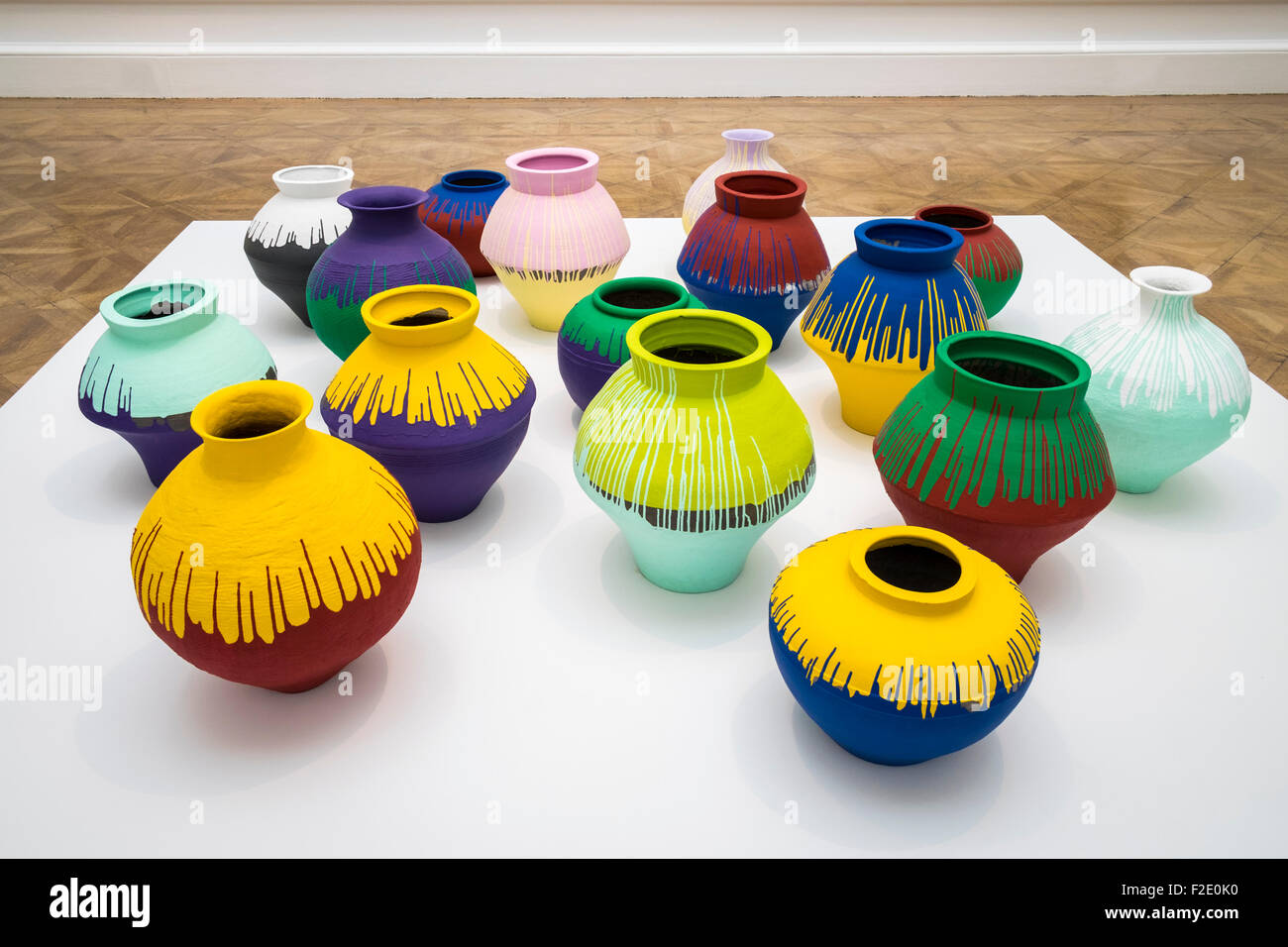 Ai Weiwei, twelve Han Dynasty and four neolithic vases with industrial paint at the Royal Academy of Arts Exhibition - Stock Image