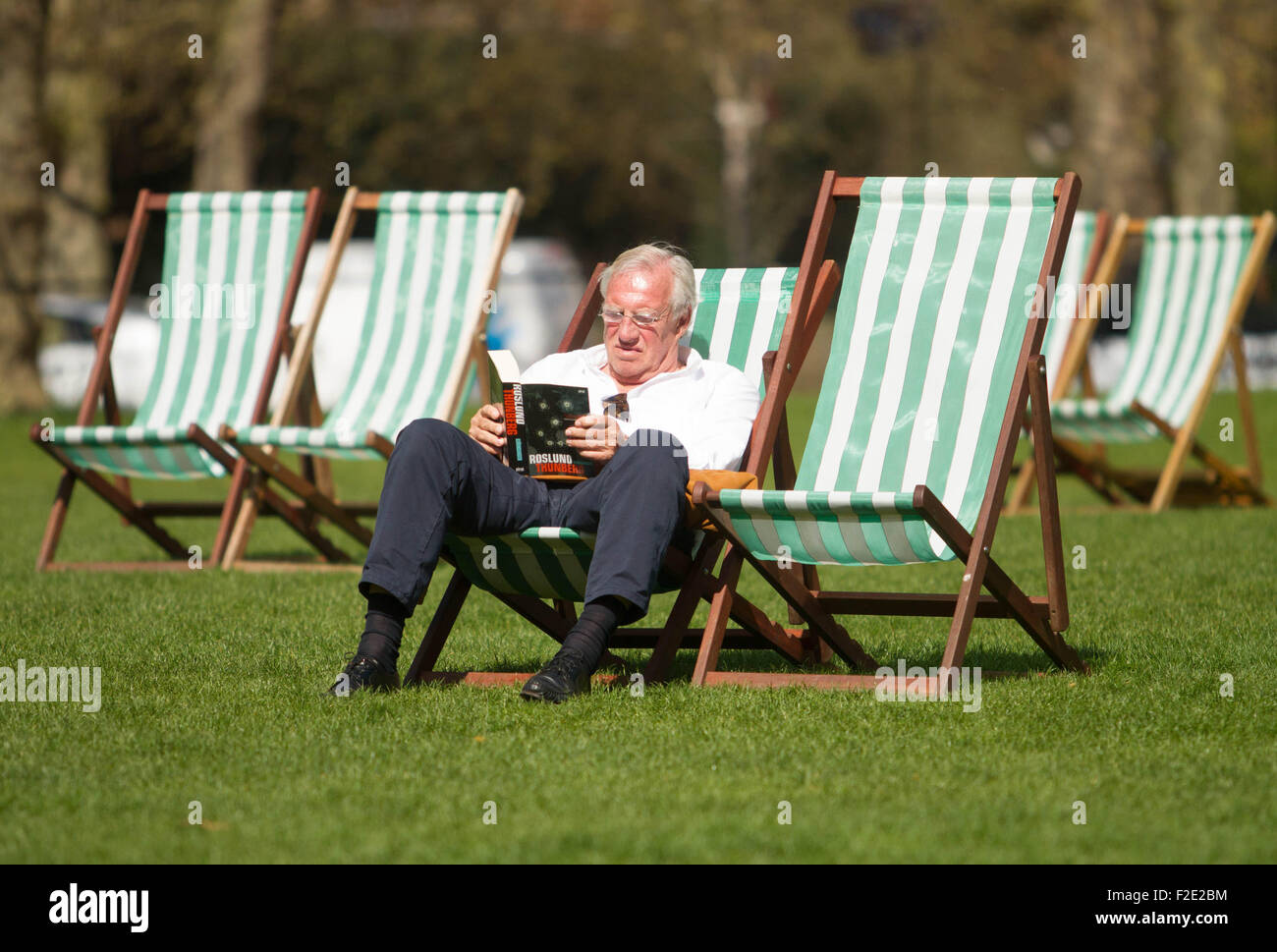 a man enjoying the hot weather in green park, in London, as its the hottest day of the year. Stock Photo