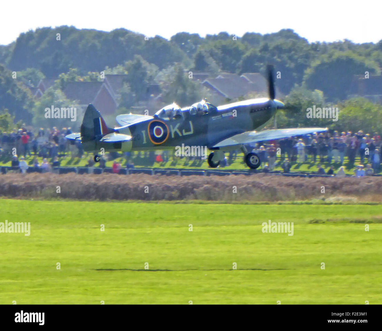 A Vickers Supermarine Spitfire Two Seat Monoplanefighter trainer taking off at Goodwood for the Battle of Britain - Stock Image