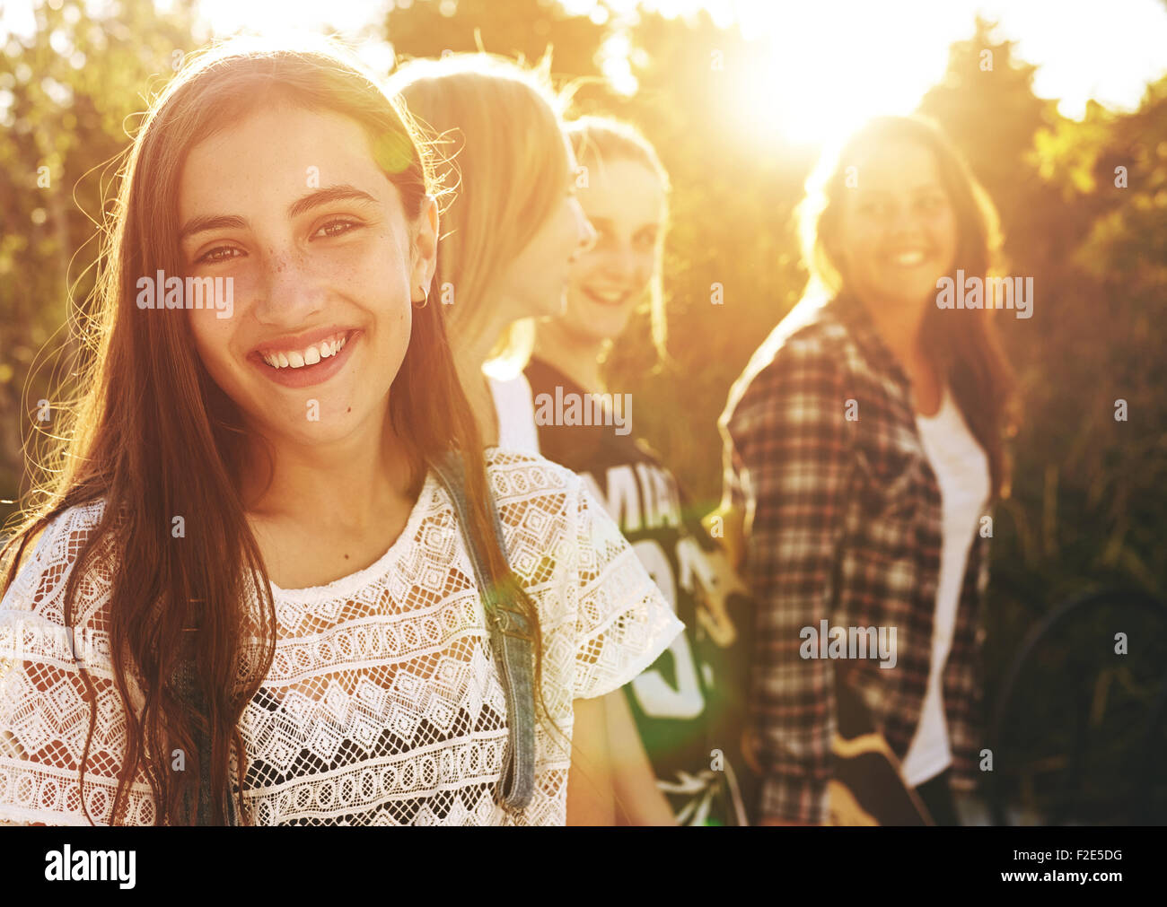 Portrait of group of friends, one smiling at camera - Stock Image