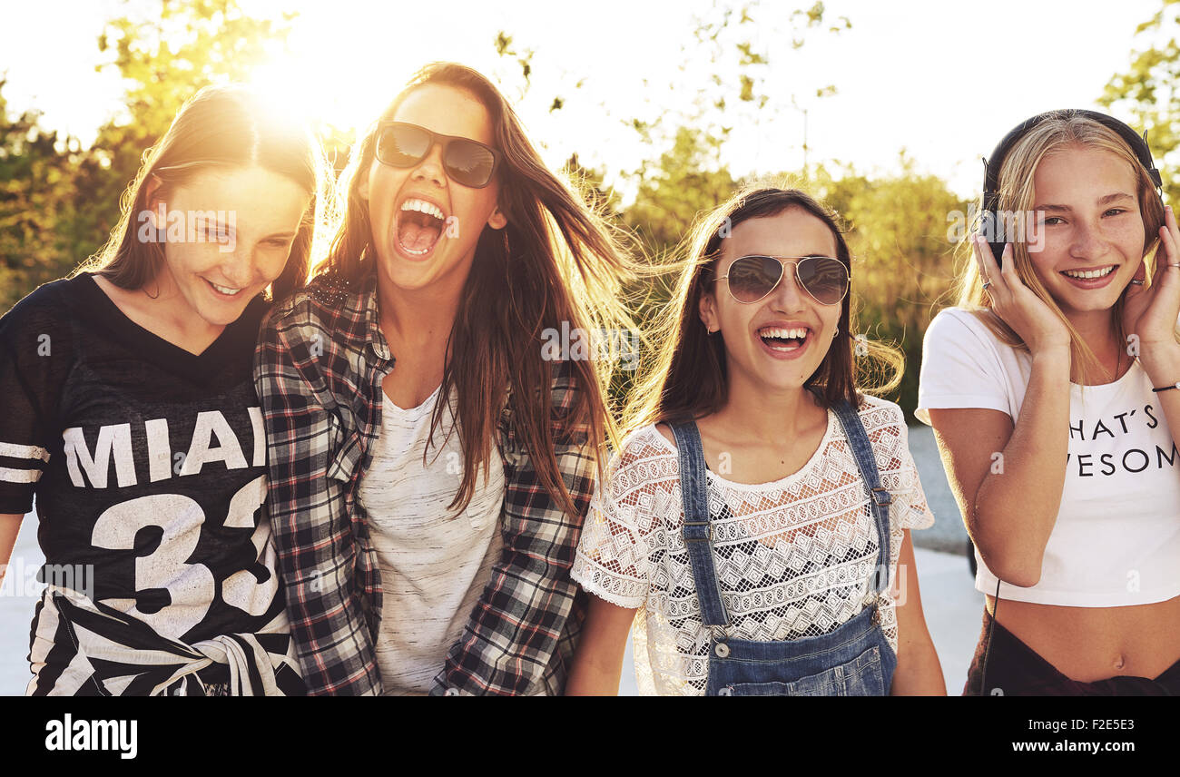 Group of teenagers laughing out loud on s summer day - Stock Image