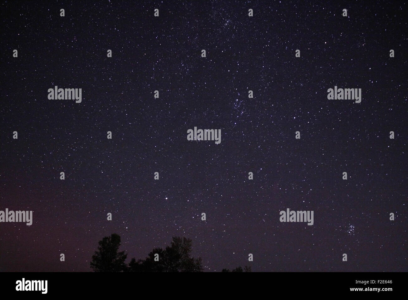 Night sky with stars and celestial objects including Constellation Perseus in the middle right night sky - Stock Image