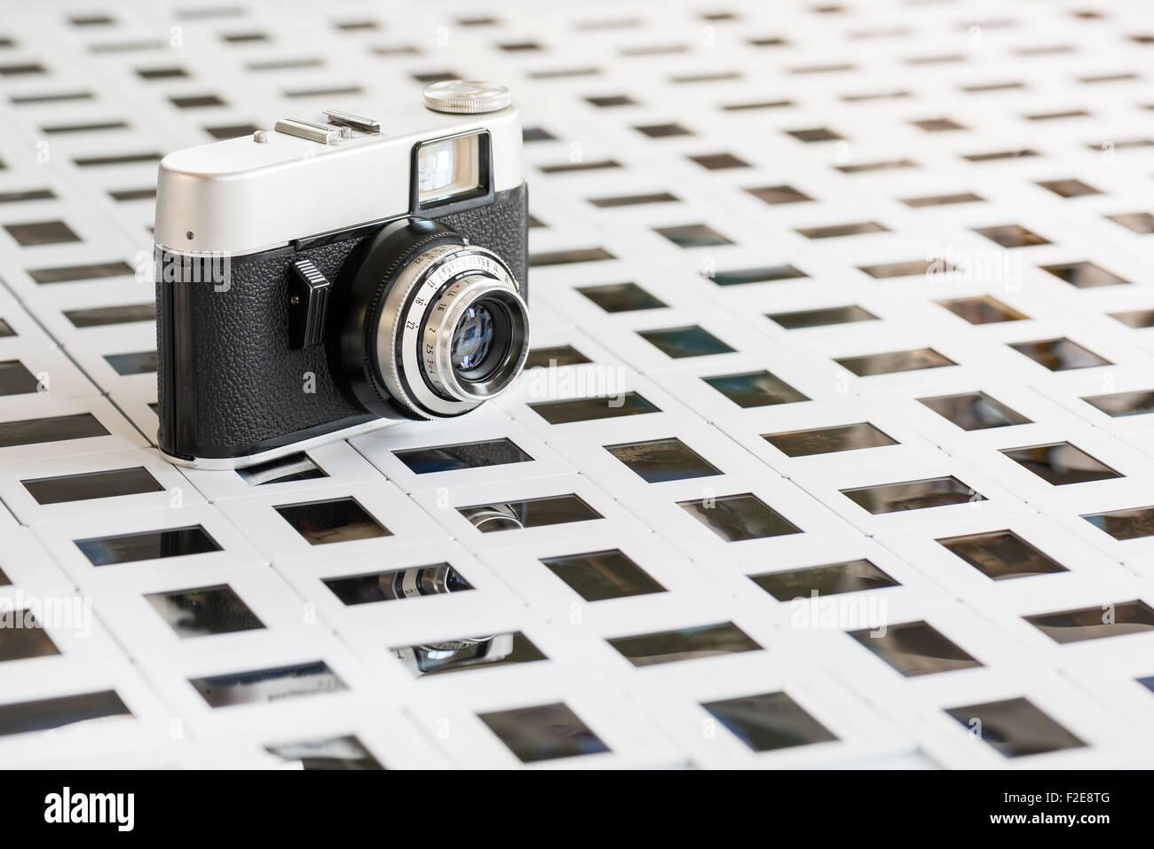 old camera resting on floor of slide - Stock Image