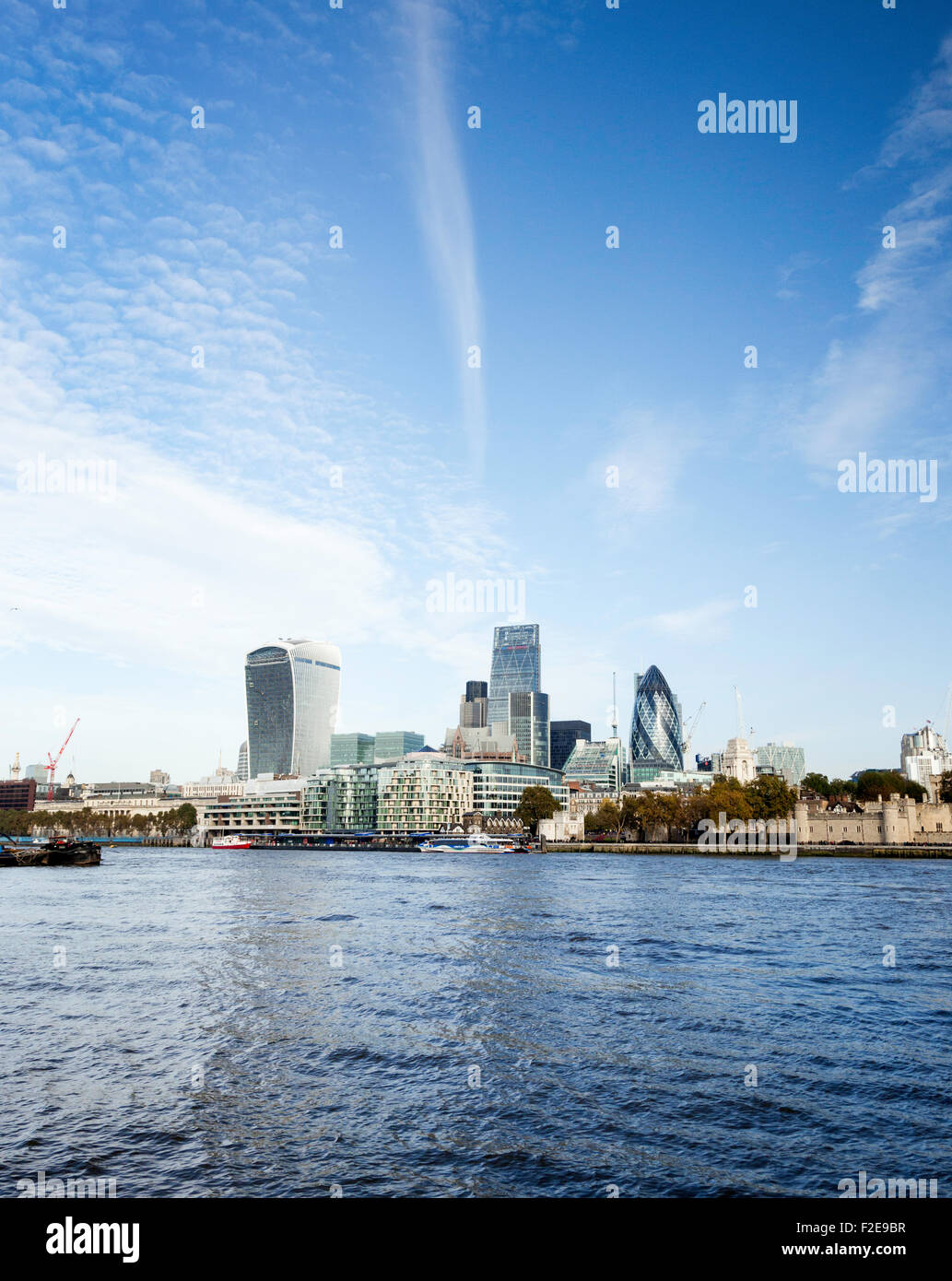 A London skyline image of the North Bank  buildings across the River Thames in the United Kingdom. - Stock Image