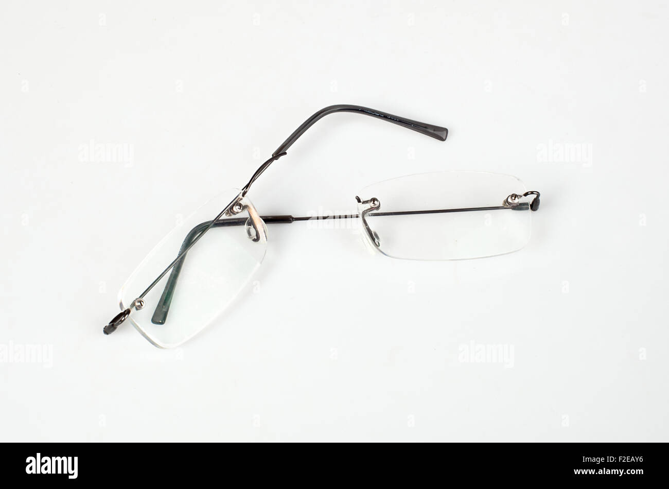 Eyeglasses with lightweight frame broken on white table Stock Photo ...