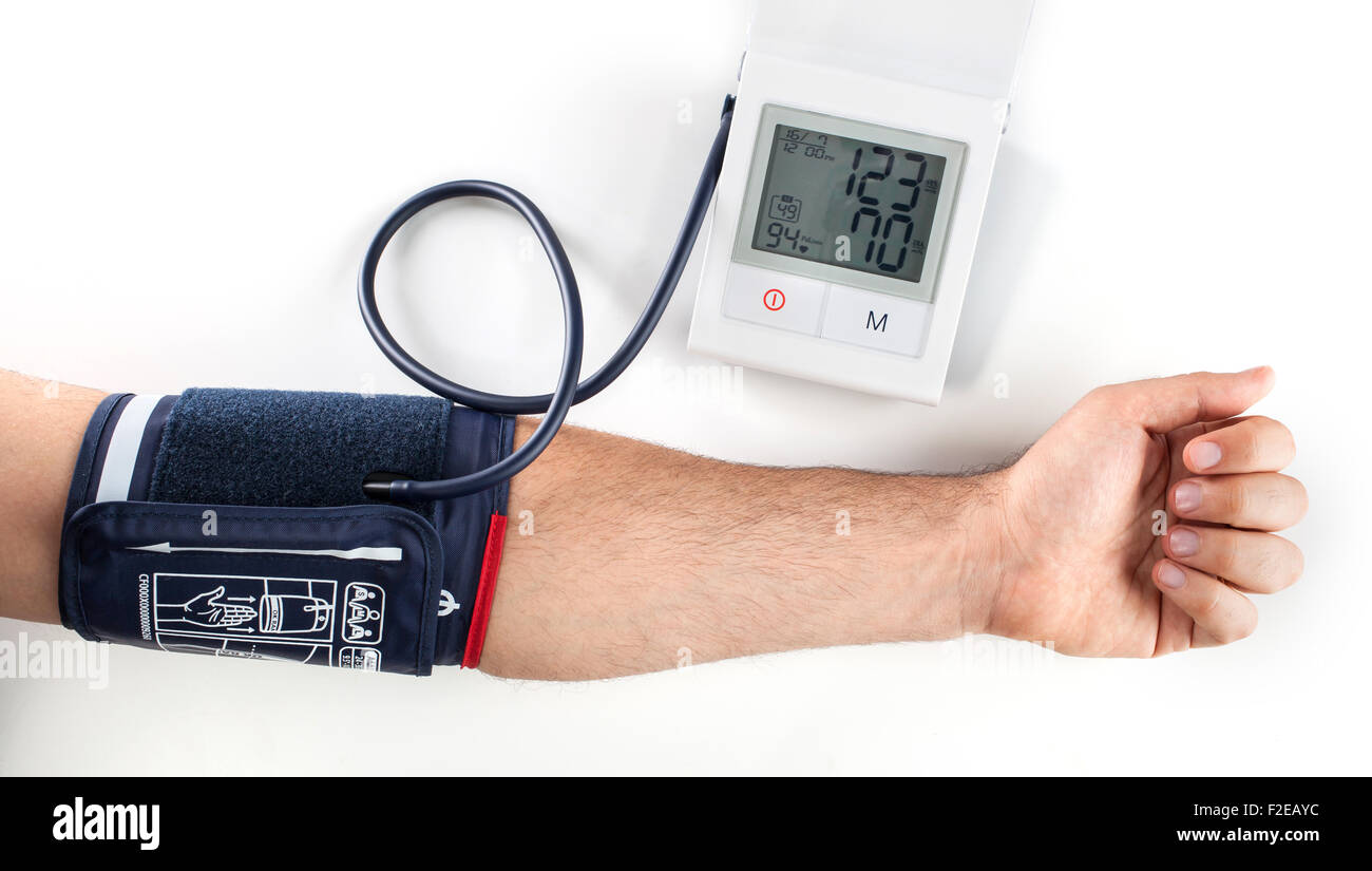 Checking the blood pressure with a modern digital equipment - Stock Image