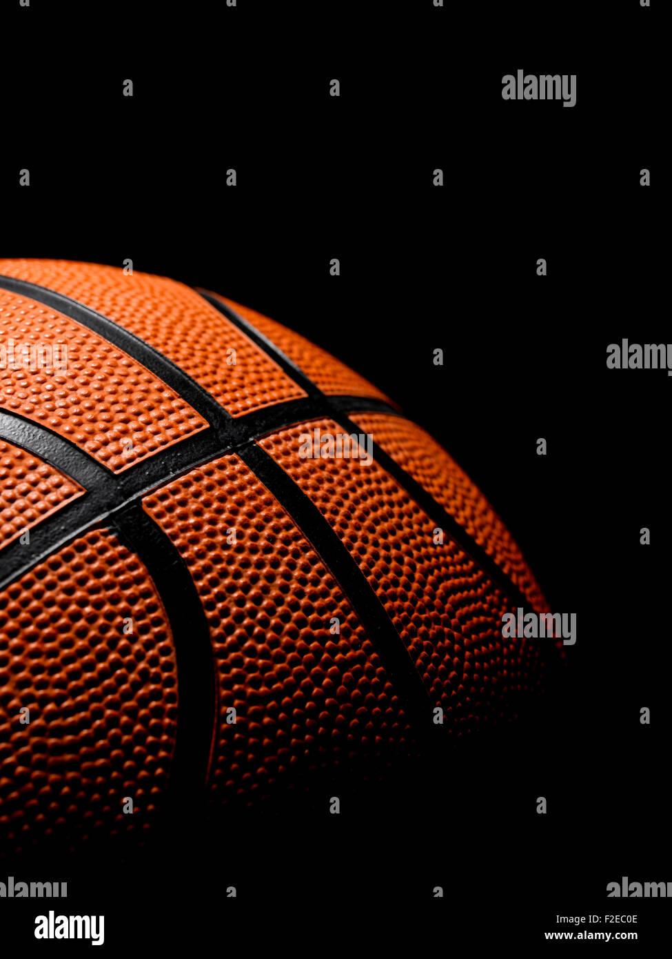 Single Basketball on a black background - Stock Image