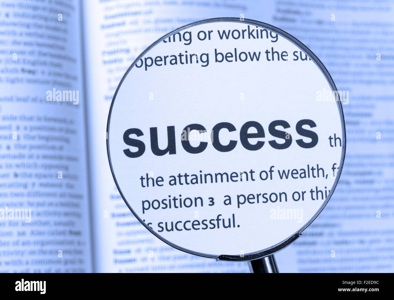 Success text highlighted through a magnifying glass - Stock Image