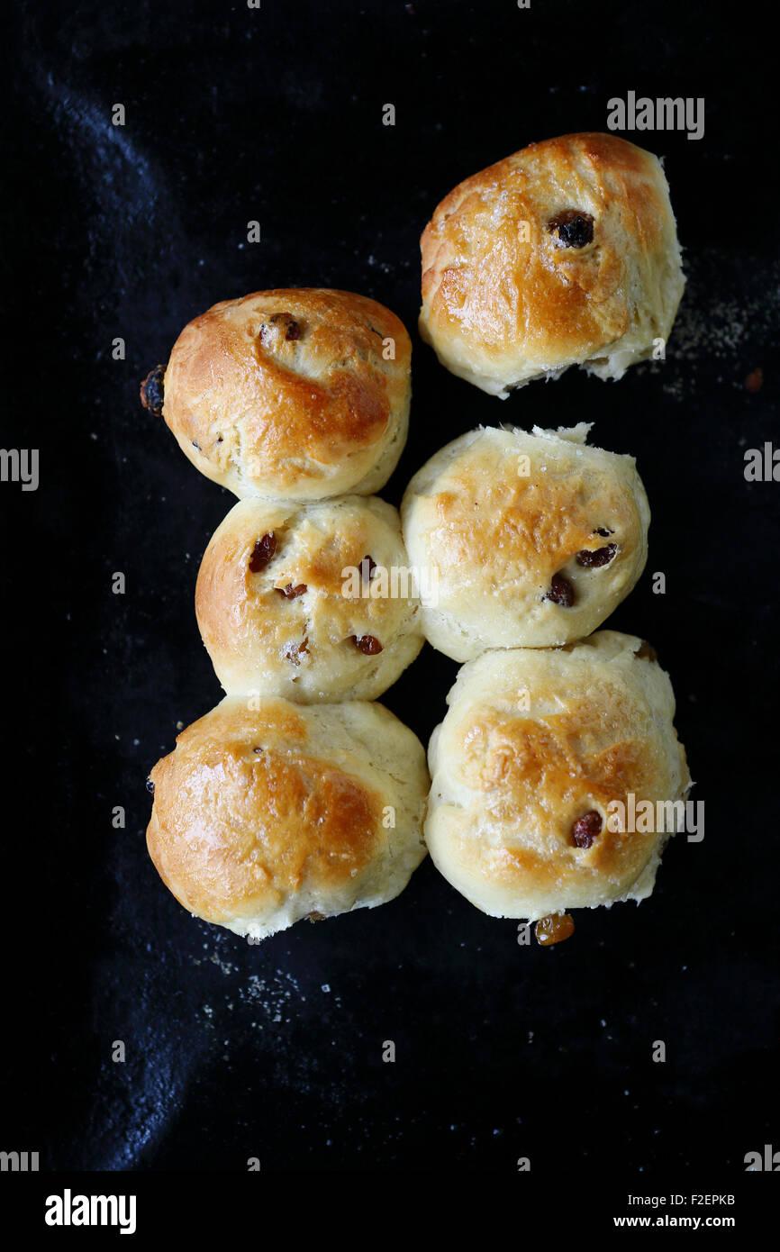 Tasty buns with raisins. Sweet food - Stock Image