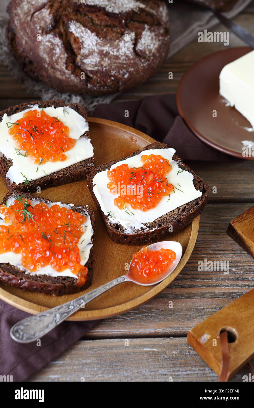 Bread and butter with caviar on a plate, food - Stock Image