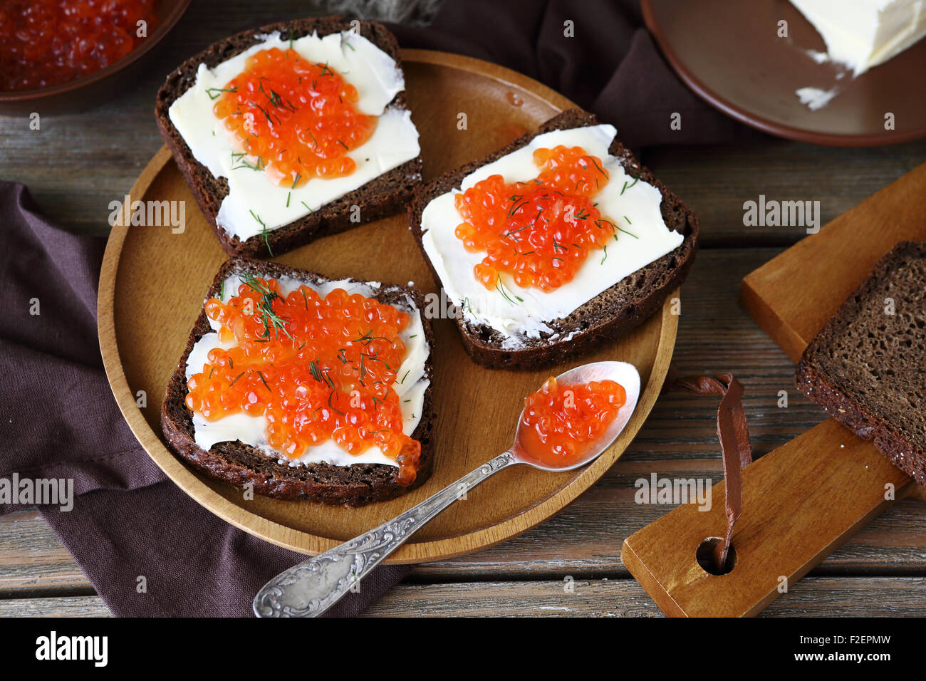 Delicious canapes with caviar on a plate, food - Stock Image