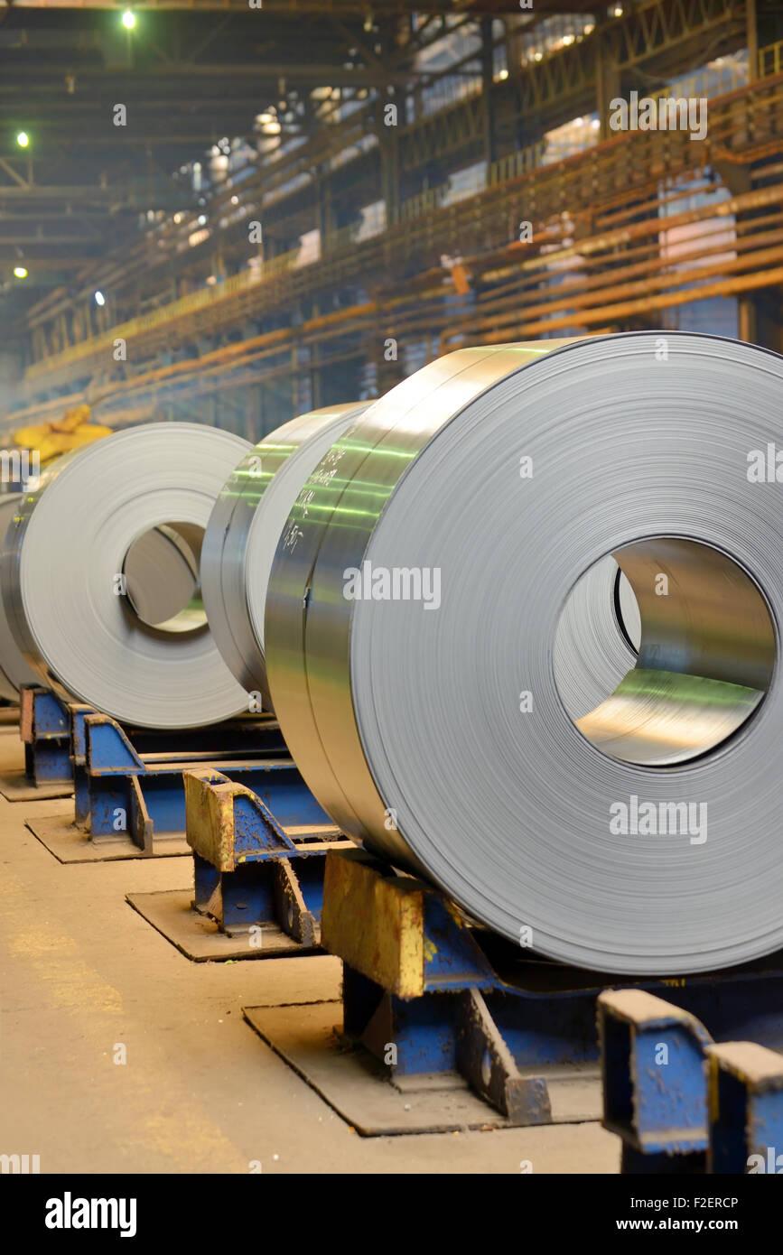 Rolls of metal sheet inside of steel plant Stock Photo