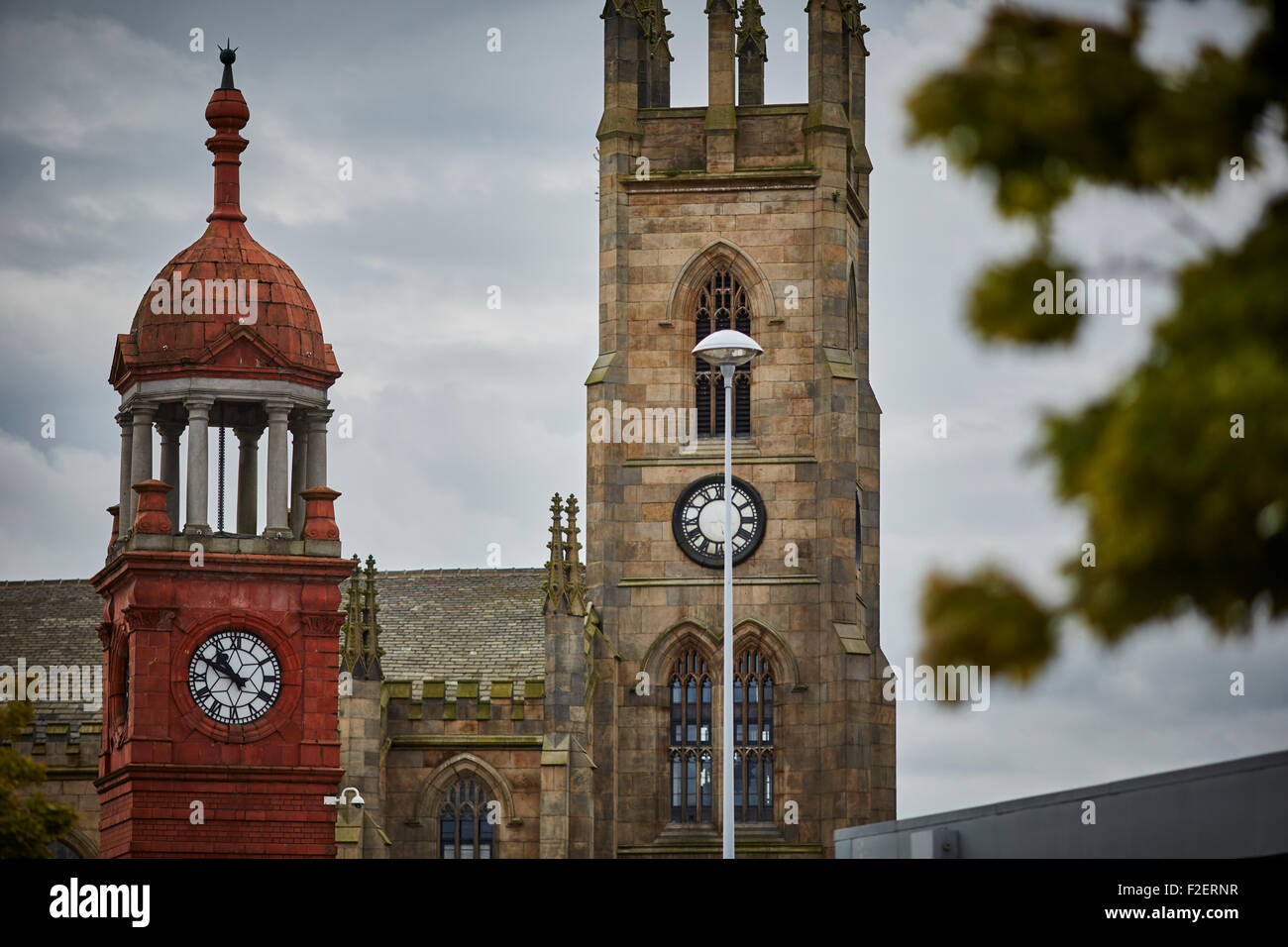 The Church of the Holy Trinity Bolton in the County of Lancashire framed by Gateway Bridge Arch  Holy Trinity Church - Stock Image