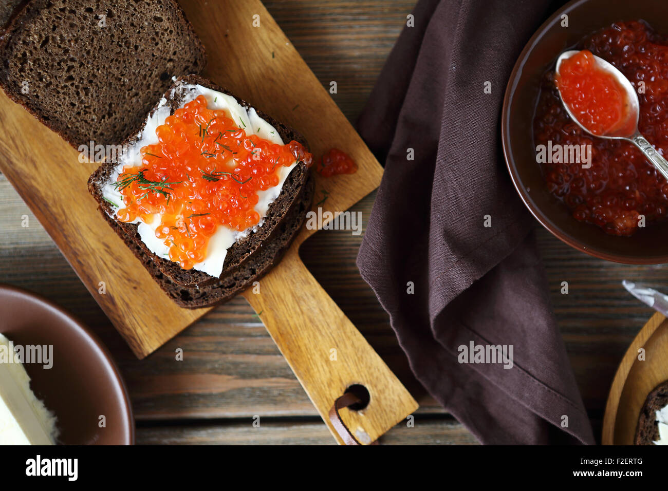 Sandwich with caviar on the board, food - Stock Image