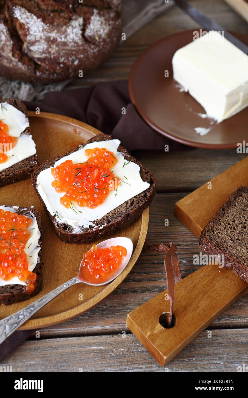 Sandwich with caviar and butter on a plate, top view Stock Photo