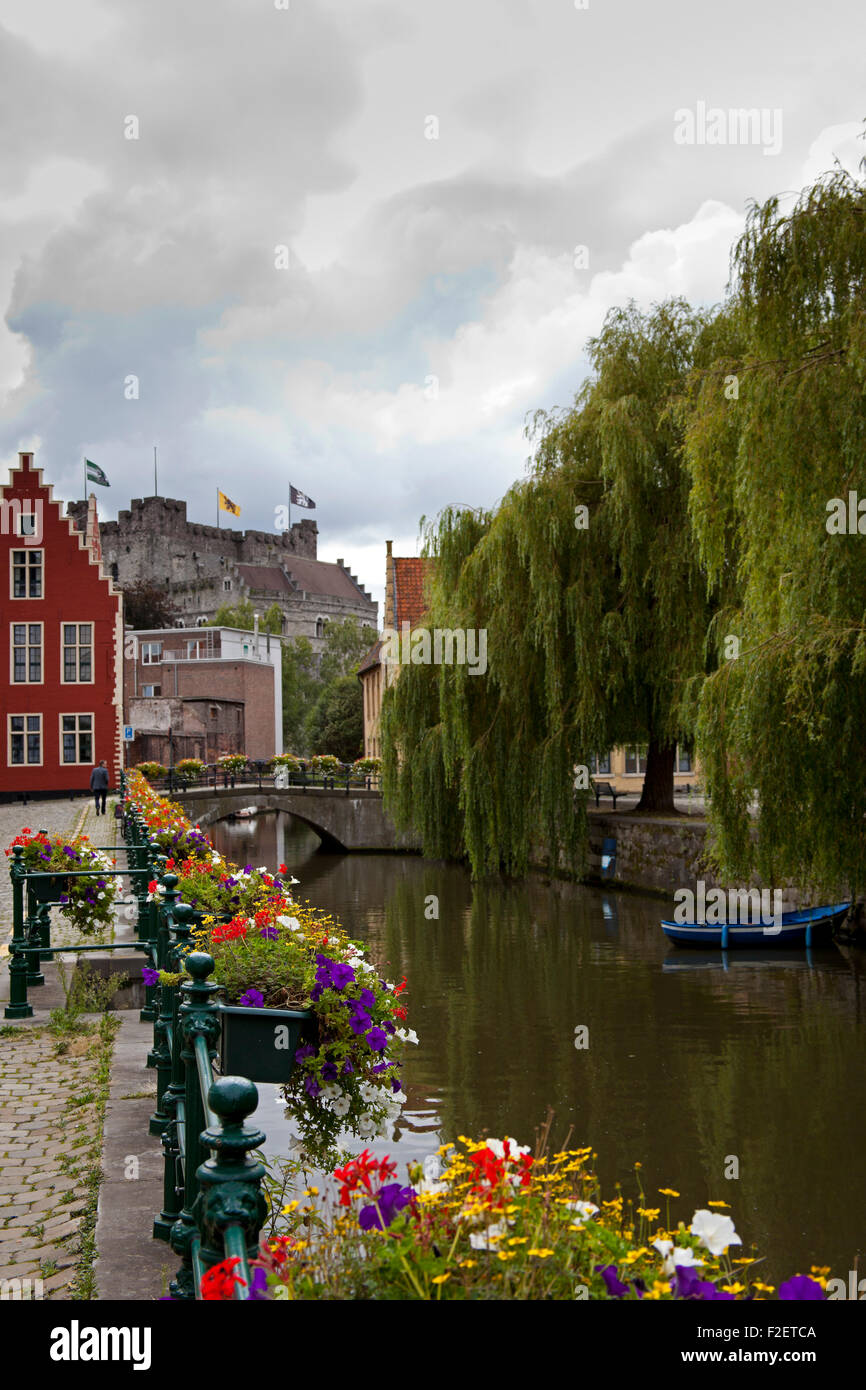 Ghent Leie river boat with Gravensteen castle in background Europe - Stock Image