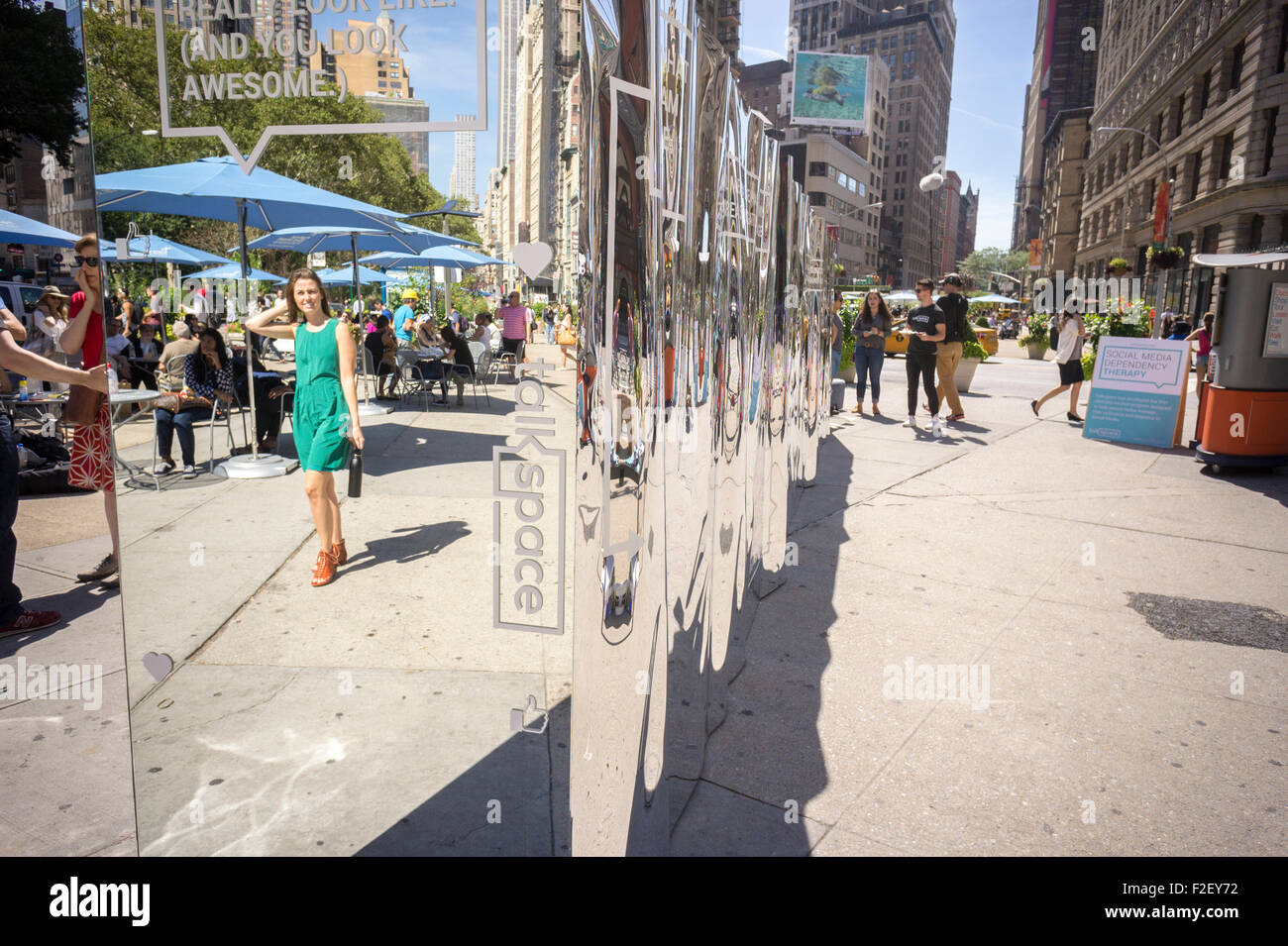 A promotion for Talkspace in Flatiron Plaza in New York promotes their Social Media Dependency Therapy (SMDT) on - Stock Image