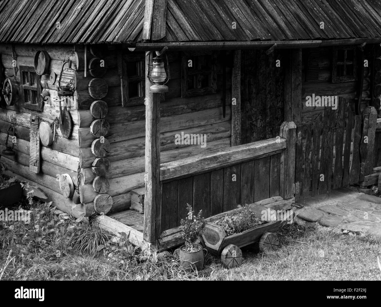 black and white photo of old wooden house. - Stock Image