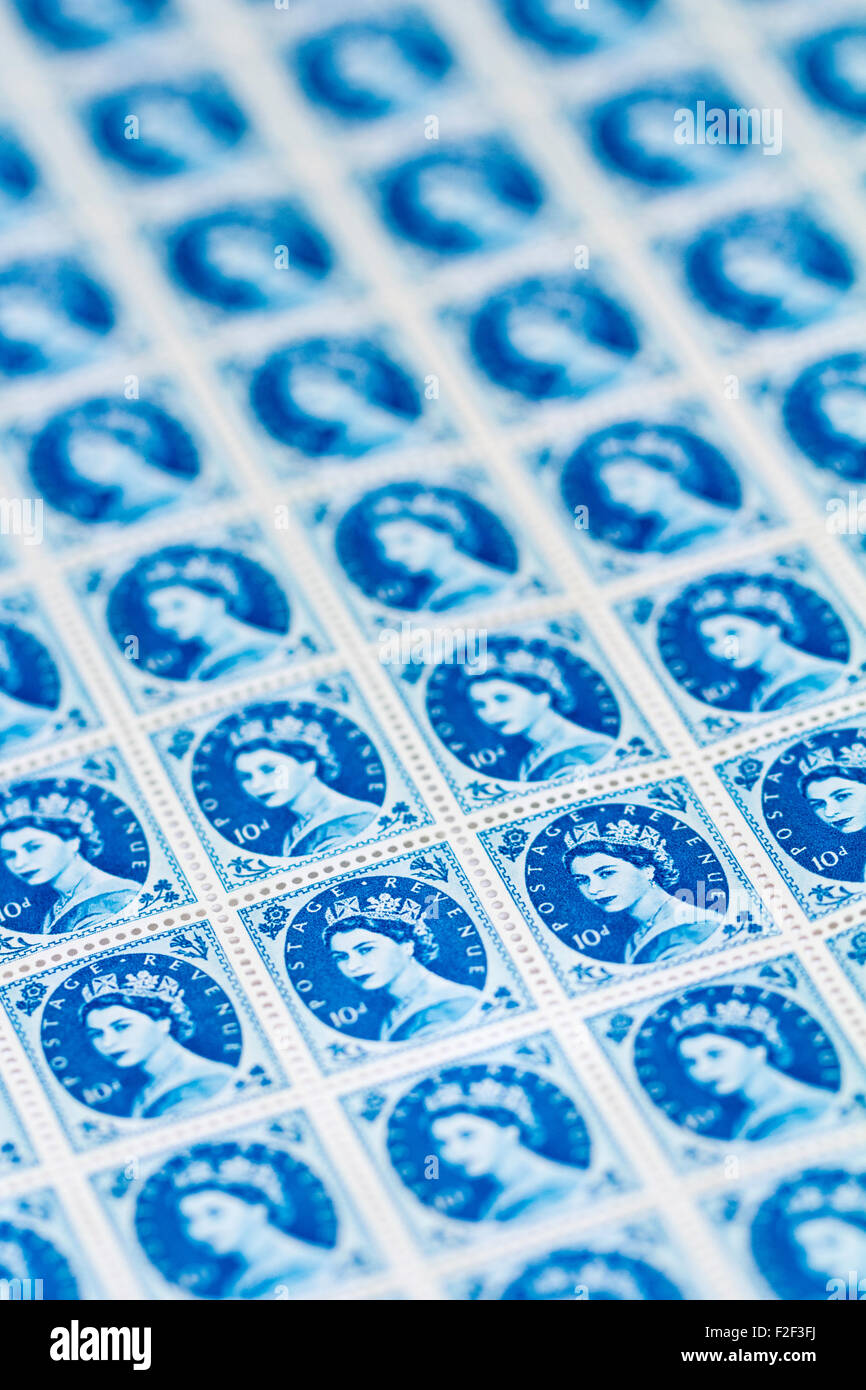 Sheet of 1950's British Royal Mail 10d blue postage stamps from the Wildings definitive issue with portrait of Queen Stock Photo
