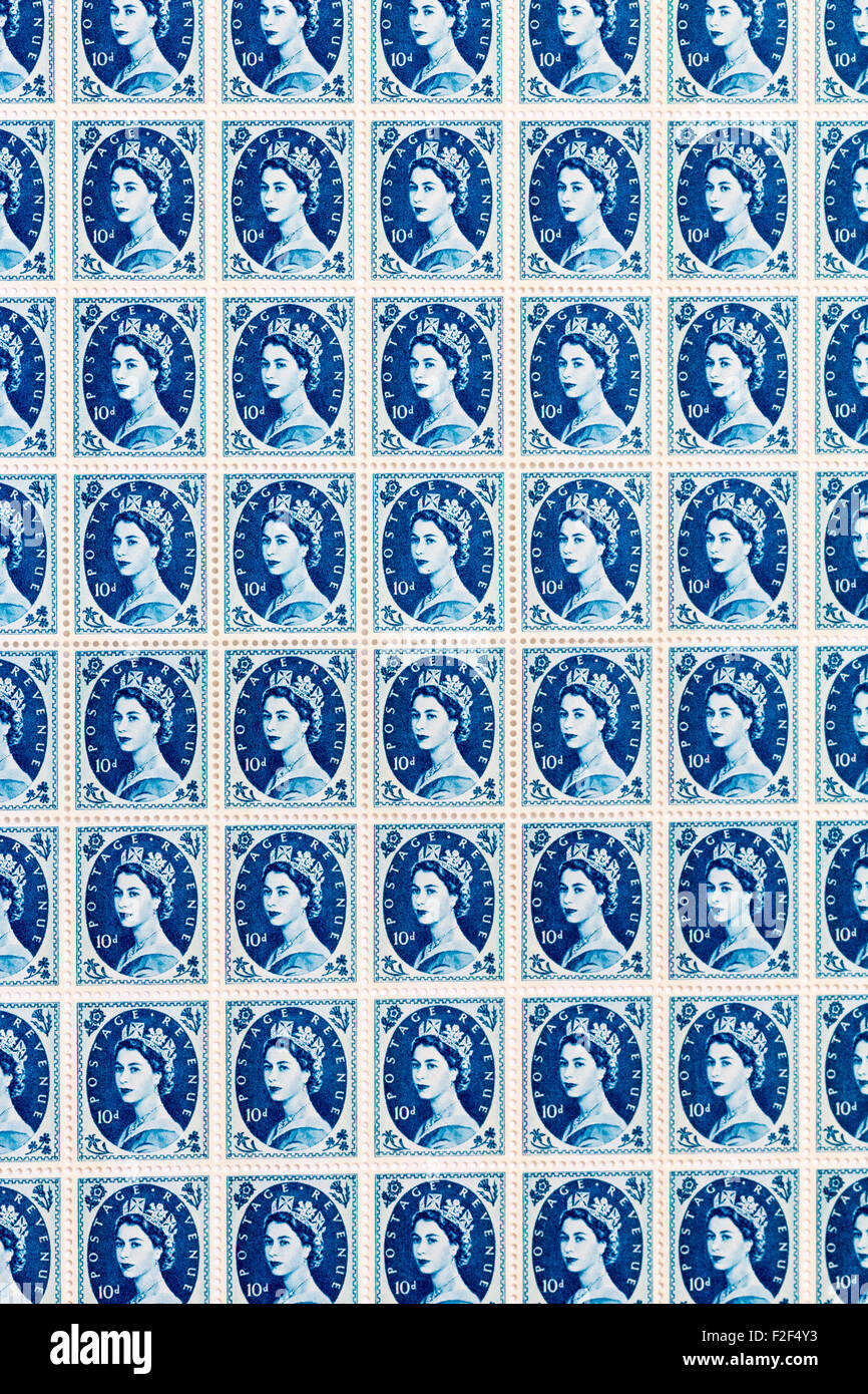 Sheet of 1950's British Royal Mail 10d blue postage stamps from the Wildings definitive issue with portrait - Stock Image