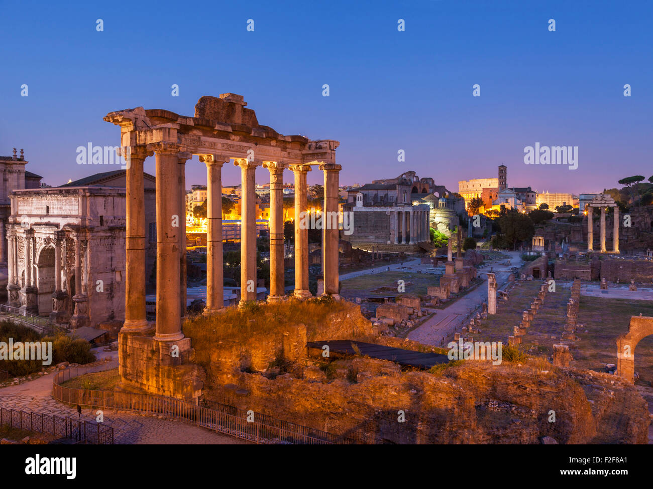 The columns are the ruins of The Temple of Saturn, a temple to the god Saturn in the Roman Forum  Rome Lazio  Italy - Stock Image
