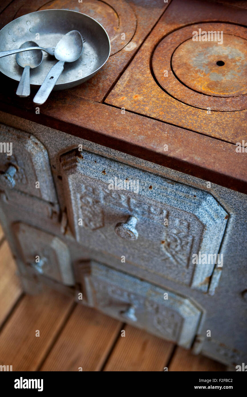 Rusty old stove in a flea market - Stock Image