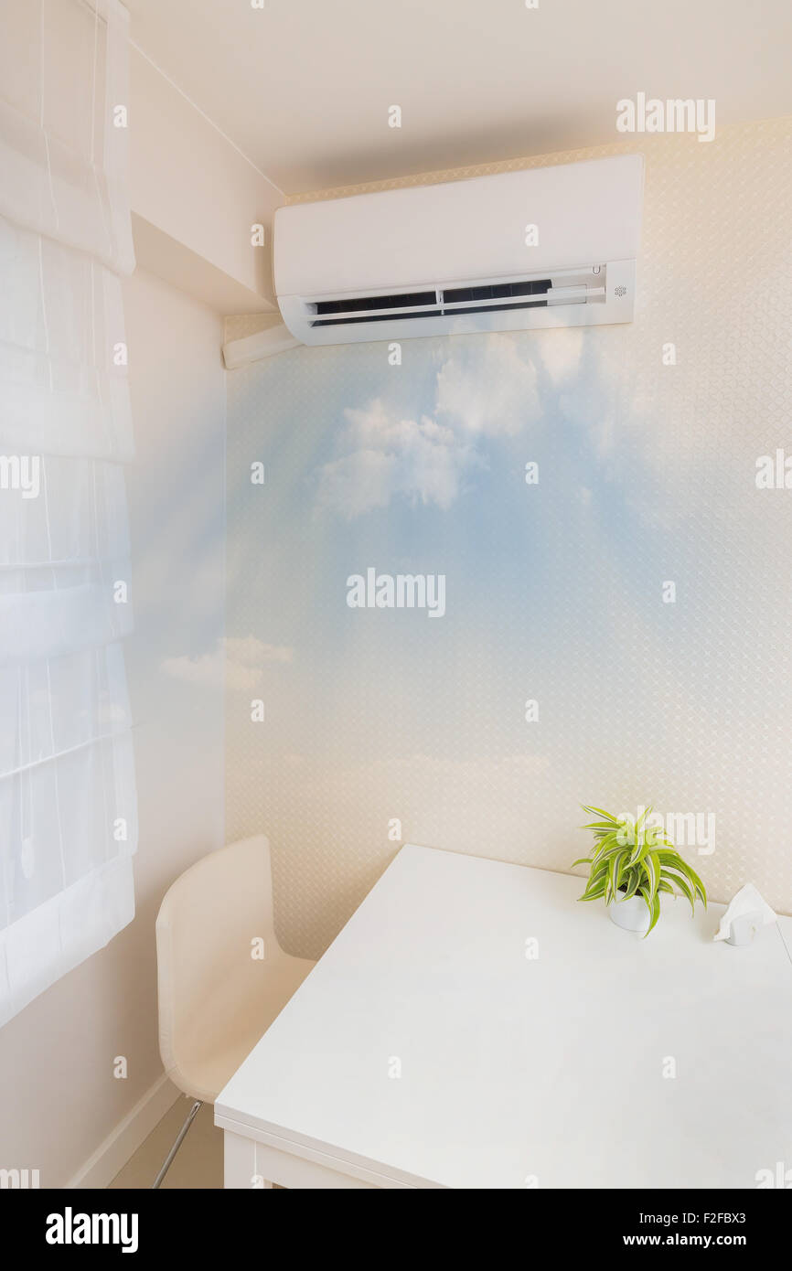 Air conditioner blowing cold air. Home interior concepts. - Stock Image