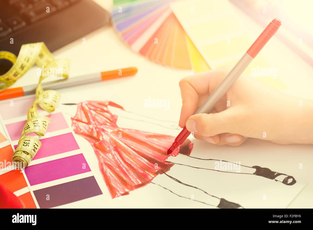 Fashion designer working in studio. Close up design. - Stock Image